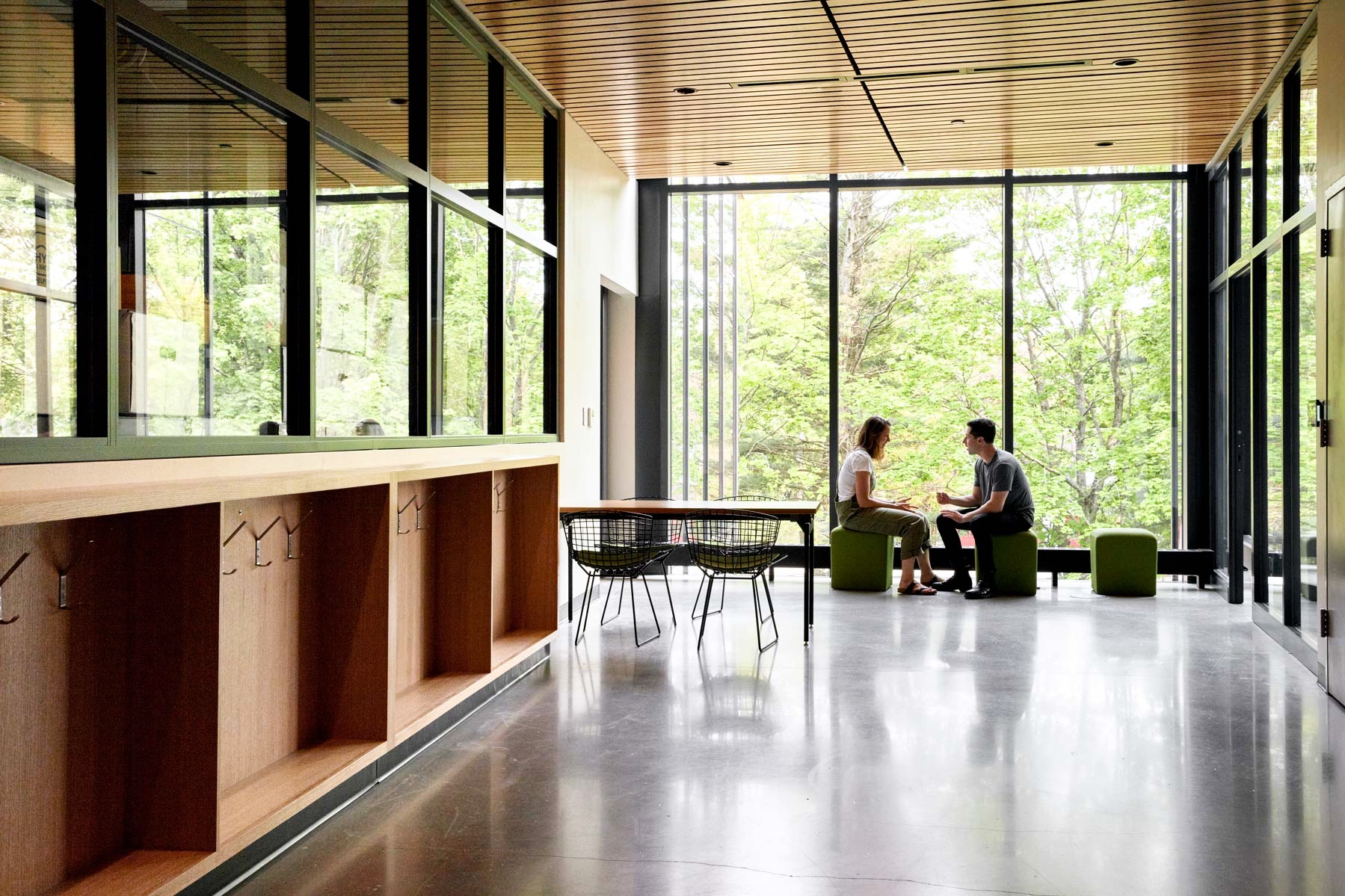 The building was positioned intentionally with windows to the south and north to capitalize on peak daylight hours. Here, a shot of the windows on the third floor shows the abundance of natural light and treetop views.