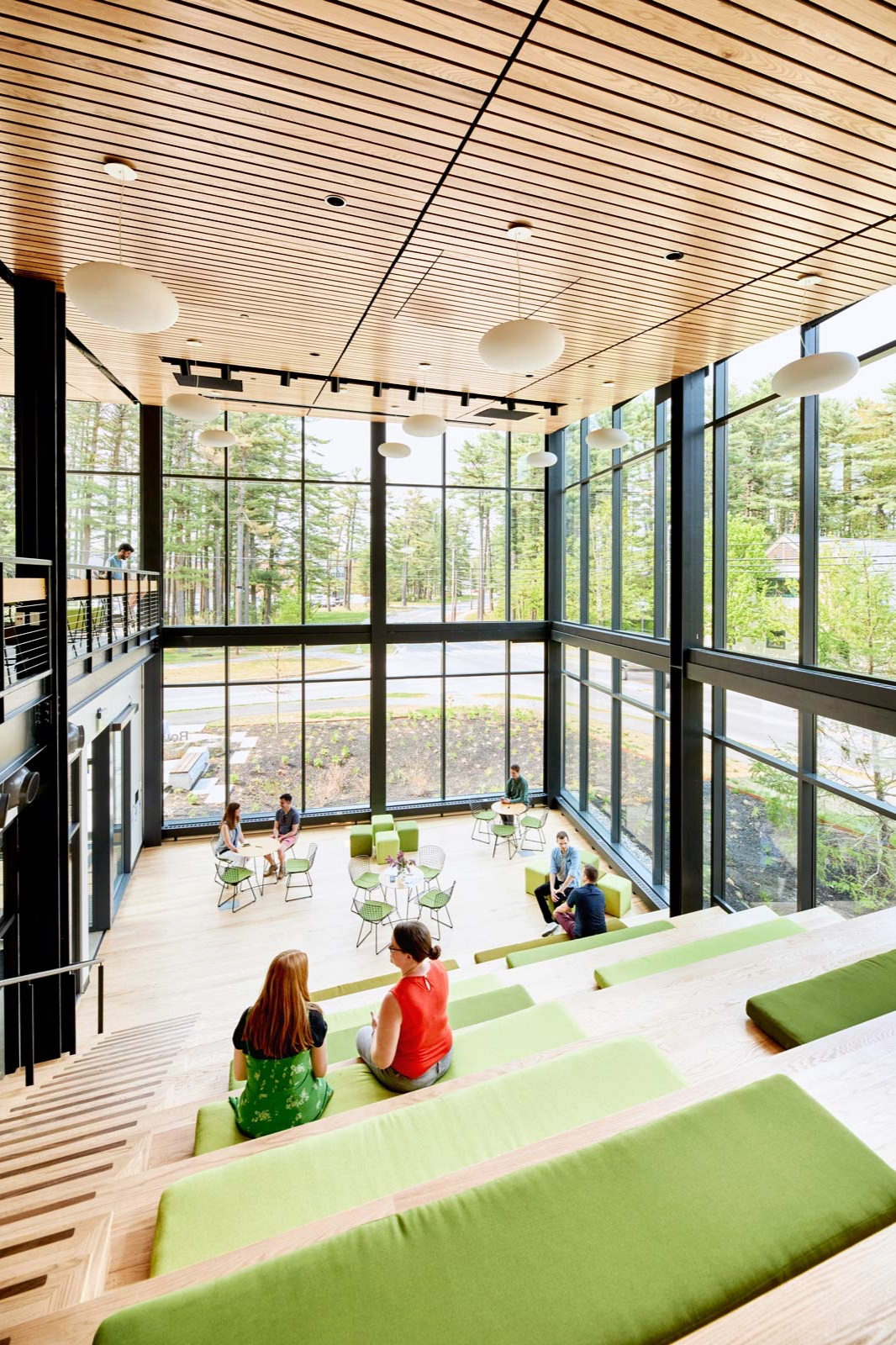 The Lantern was designed as a multipurpose space. Risers fitted with leaf-green cushions accommodate students for lectures and performances or a comfortable place to study.
