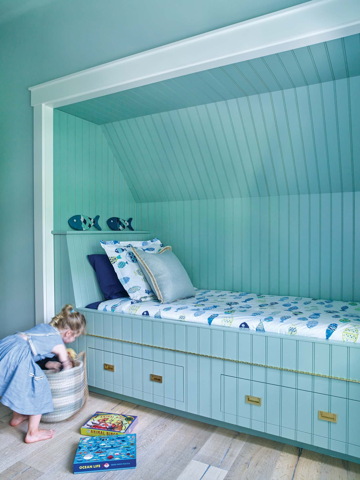 A bunk built out of space under the eave ends up giving the room a fun and funky nautical vibe.