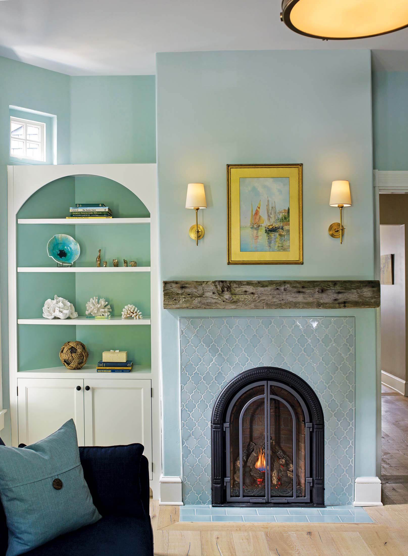 The arched fireplace is new, but Mark and Tracy found the salvaged mantel at Old House Parts Co. in Kennebunk.