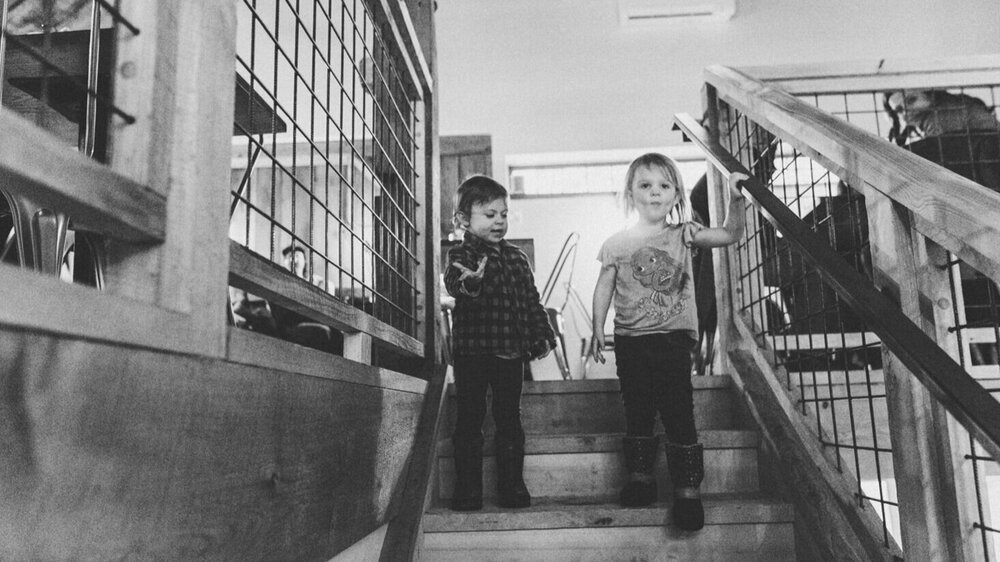 Two young visitors descend the staircase that leads to the Beer Garden's mezzanine.