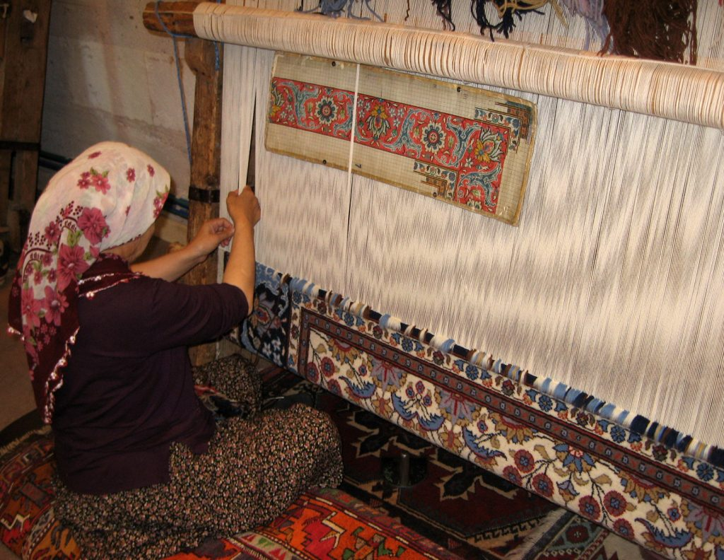 Turkish weaver creating a traditional rug
