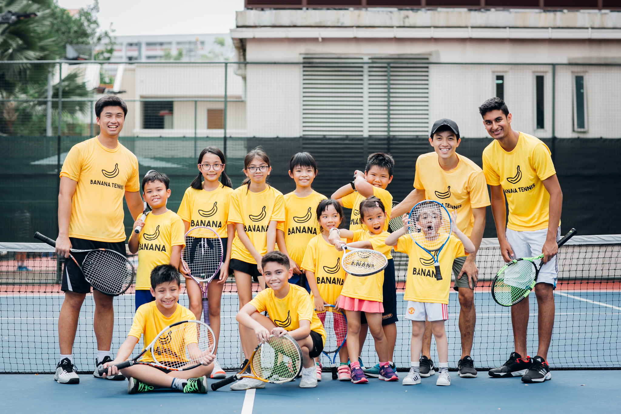 Joel Siow (far left) and Nicholas Lee (in black cap) with another Banana Tennis class.