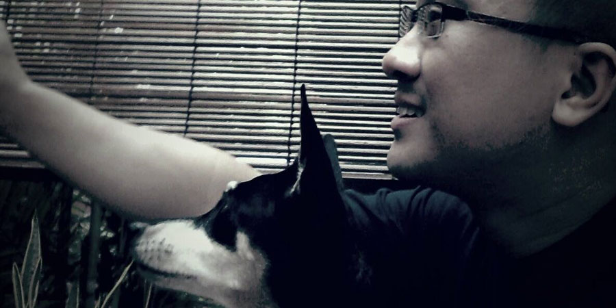Daniel Lim, chilling out with his dog in less stressful times.