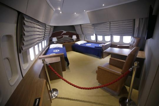 """In this Monday, Sept. 18, 2017 photo the presidential bedroom suit is seen in the """"Air Force One Experience,"""" a full-sized 747 replica of Air Force One which is now open to the public in North Kingstown, R.I. (AP Photo/Stephan Savoia)"""