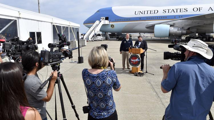 Ari Scharf, right, board chairman of the Children's Democracy Project, and former Air Force One flight attendant Howie Franklin address members of the media during a preview tour of the Air Force One replica at Quonset State Airport Sept. 14.  Photo: Michael Derr