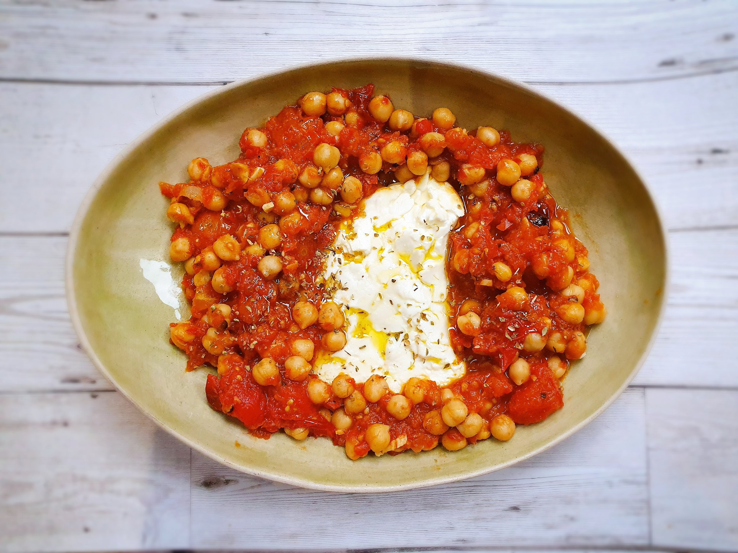 Baked feta with chickpeas and tomatoes
