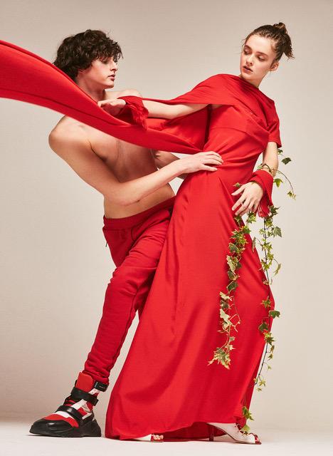 Justin: Sweatpants CULPA. Sneakers, MATTEO PRESSAMARITI  Isa: Asymmetric top MARIOS. Red dress GIORGIA ARCIDIACONO. Shoes 16R FIRENZE. Cuffs LOREDANA ROCCASALVA.