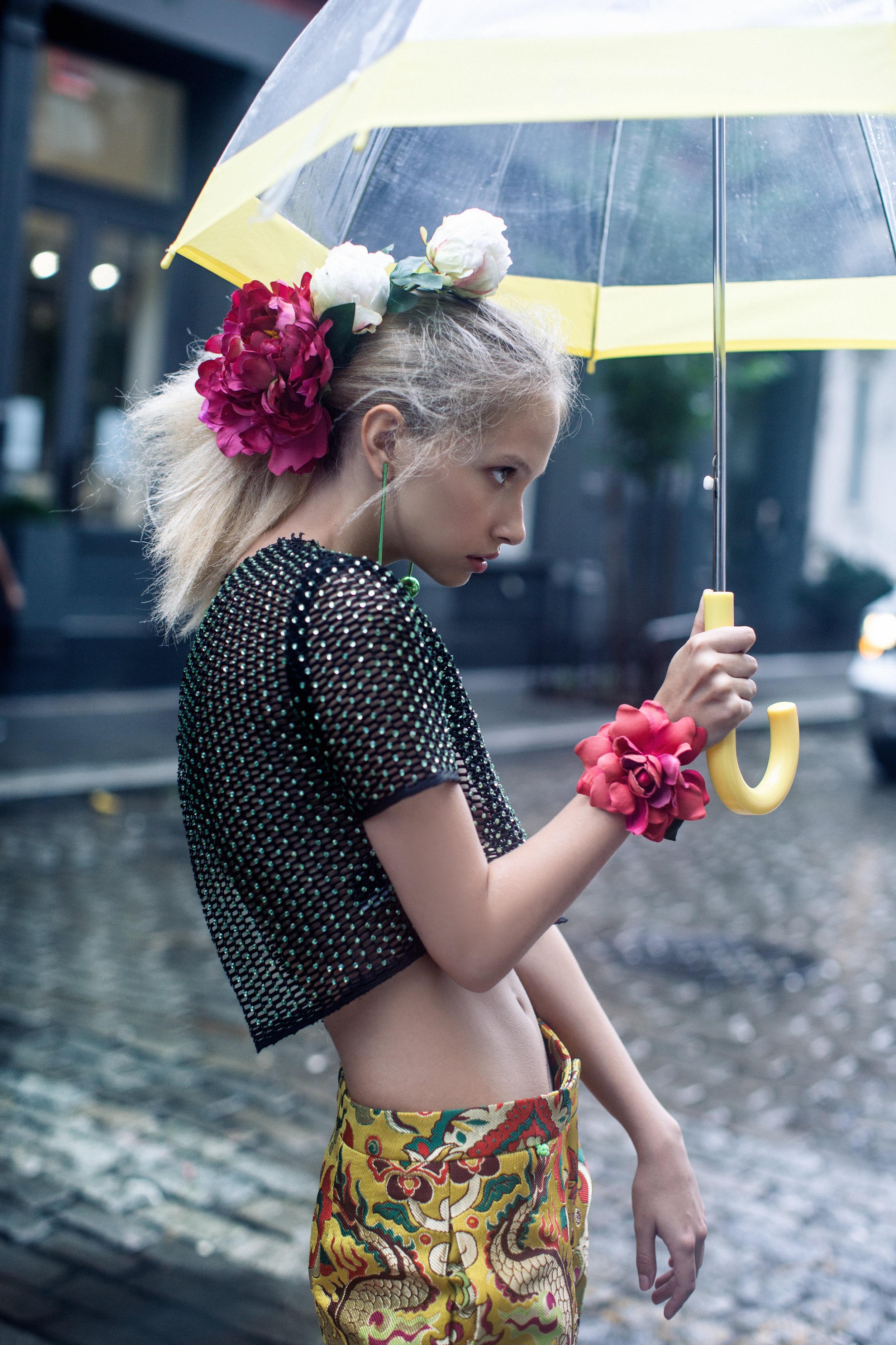 Top ALI HAIDER. Trousers THUY DESIGN HOUSE. Earrings SOLOMEINA JEWELRY. Flower bracelet AVEM. Shoes SUBIN HAHN.