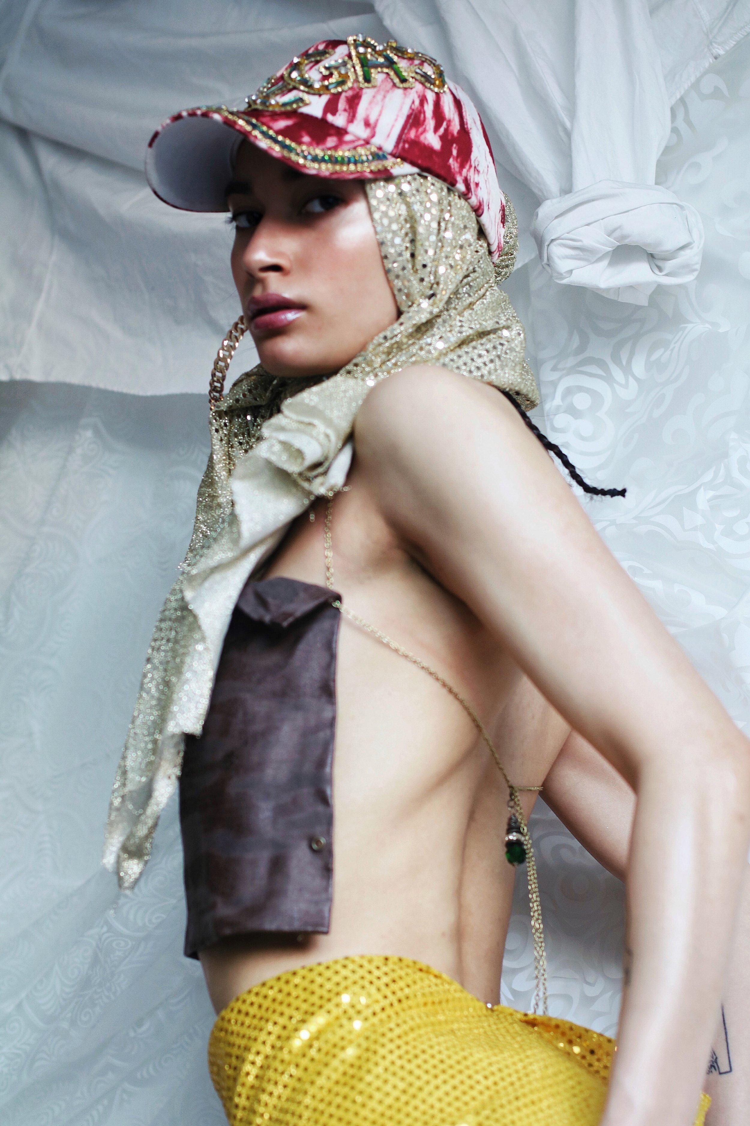 Glasses: Baby Phat.  Scarf: Balenciaga.  Skirt: Discount Universe.  Top: Helmut Lang.