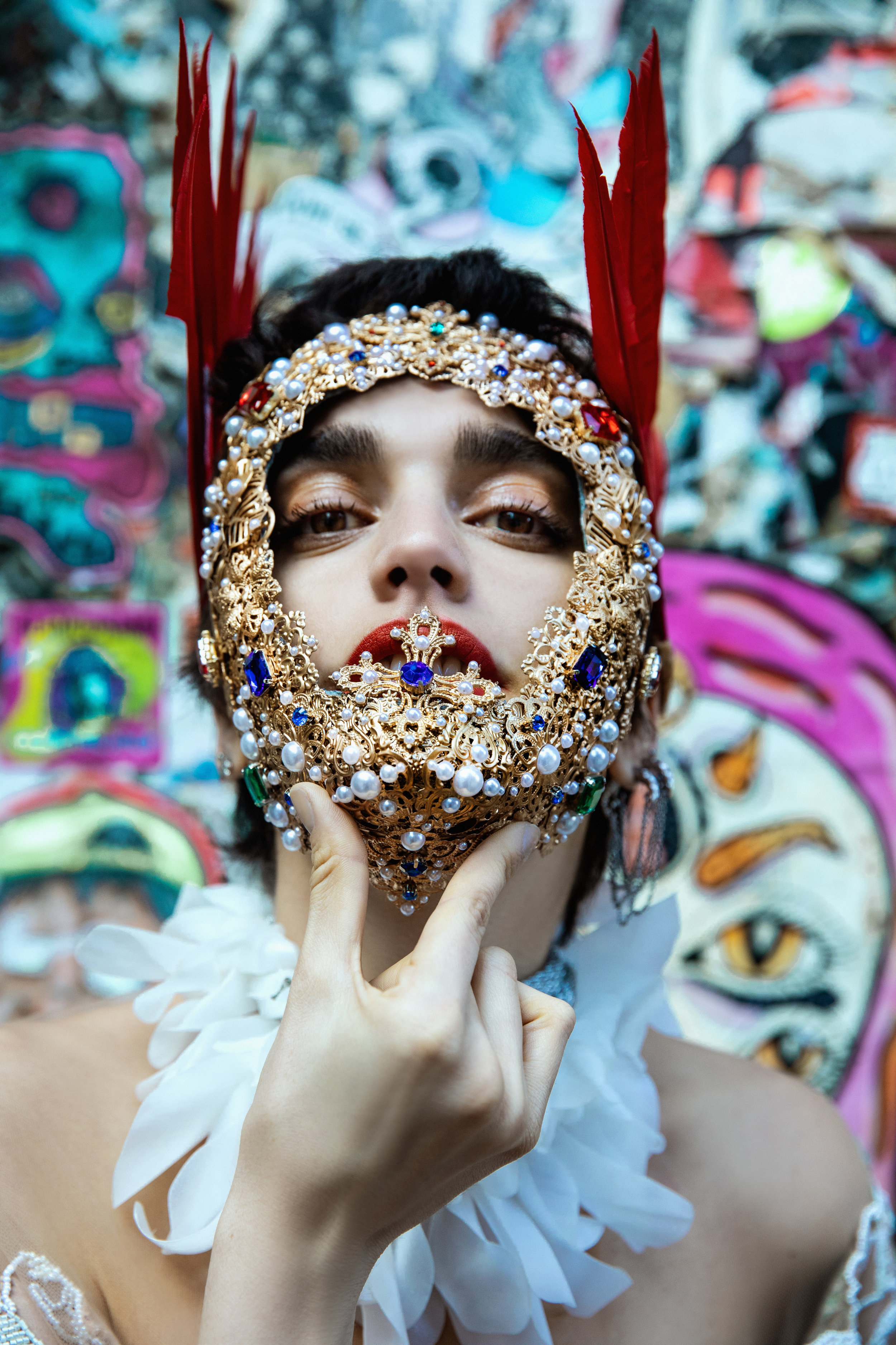 Dress ALENA AKHMADULLINA. Mask LORY SUN. Feathers MIODRAG GUBERINIC. Necklace PRESTON & LINNIE