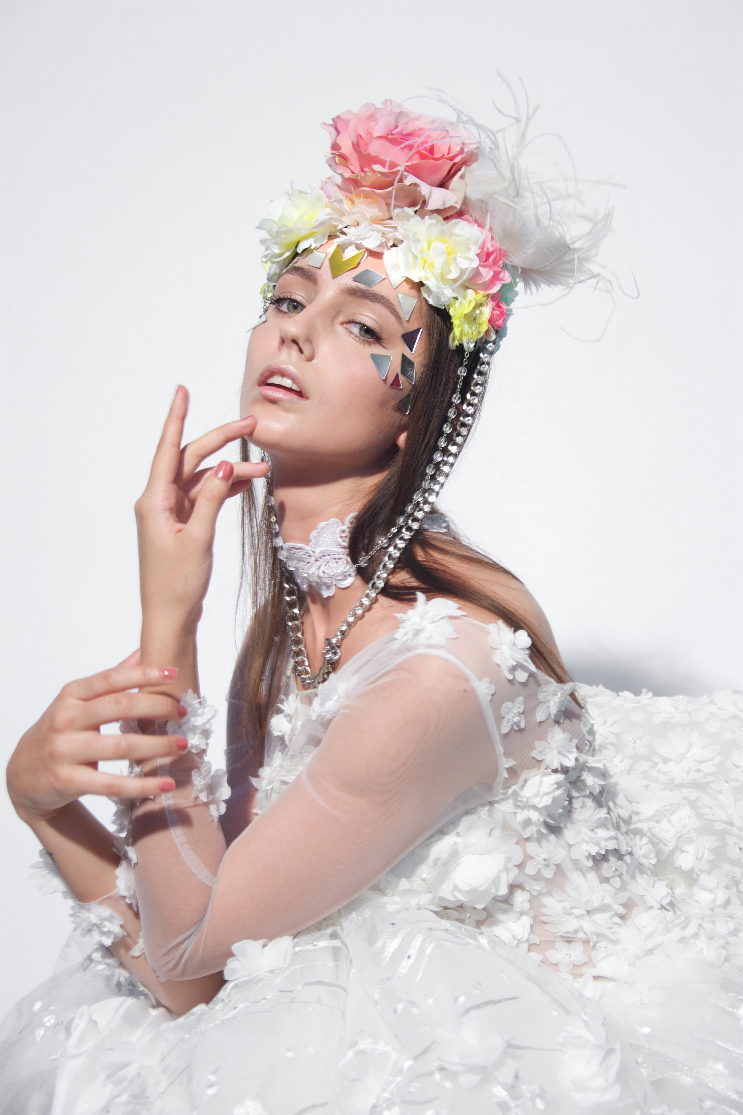 Karmen is wearing white rouches Couture dress by Filippo Laterza Flower Accessories by Helion private collection lace necklace by bassetti textile Swarowsky necklace around the neck