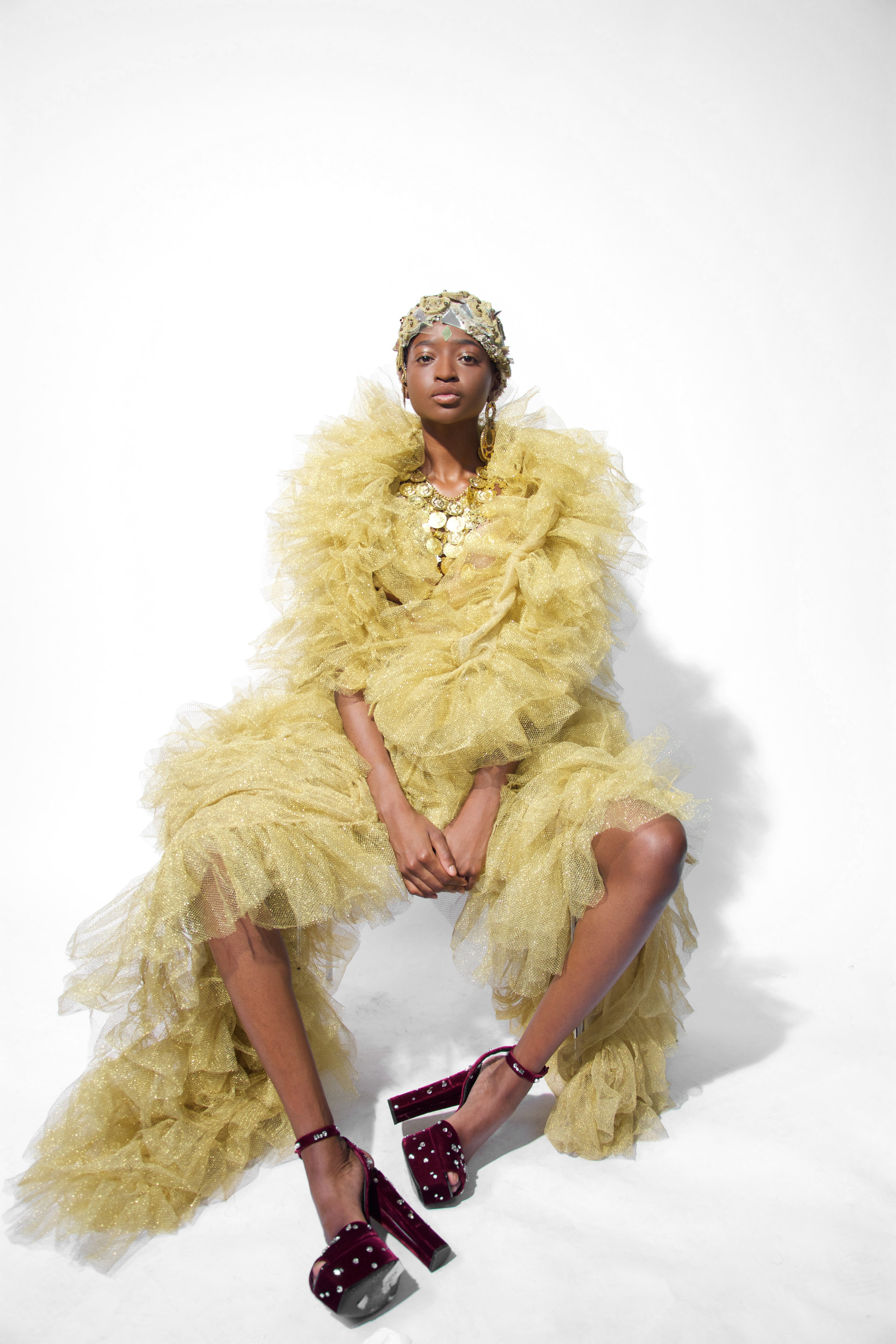 Keli is wearing Golden Tulle dress with applications by Filippo La Terza embroedery cup by Helion private collection golden medal necklace by hearing by accessorize  shoes by Giuseppe Zanotti