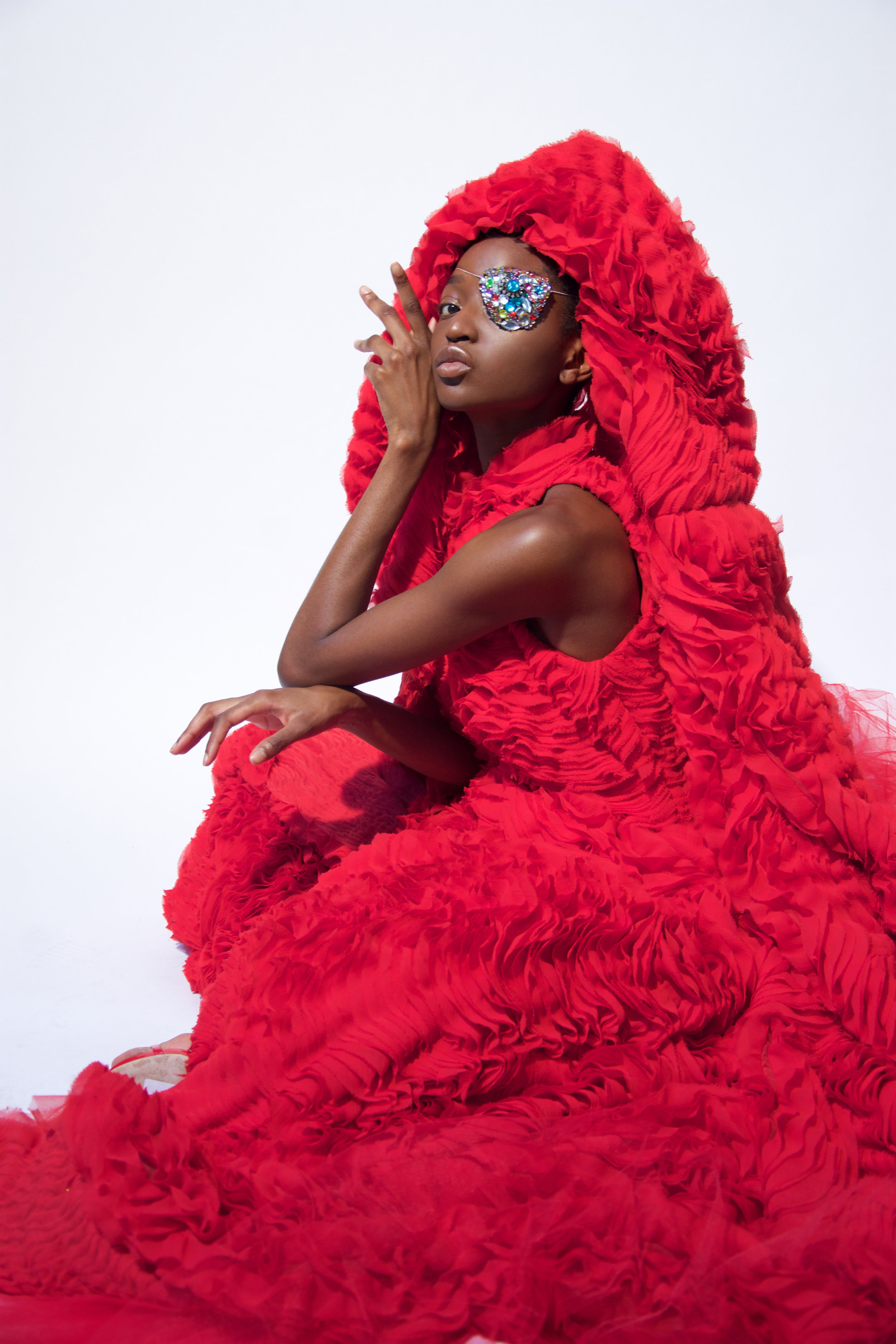 Keli is wearing Haute Couture red rouches Top and Gown by Filippo La Terza mask eye by Helion private collection hearings by Accessorize shoes by Giuseppe ZanottiNathaly is wearing couture dress by Luisa Beccaria shoes by Giuseppe Zanotti