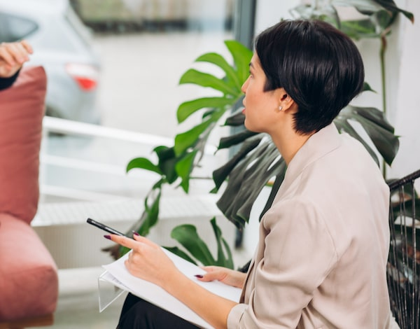 woman in business attire at group consultation