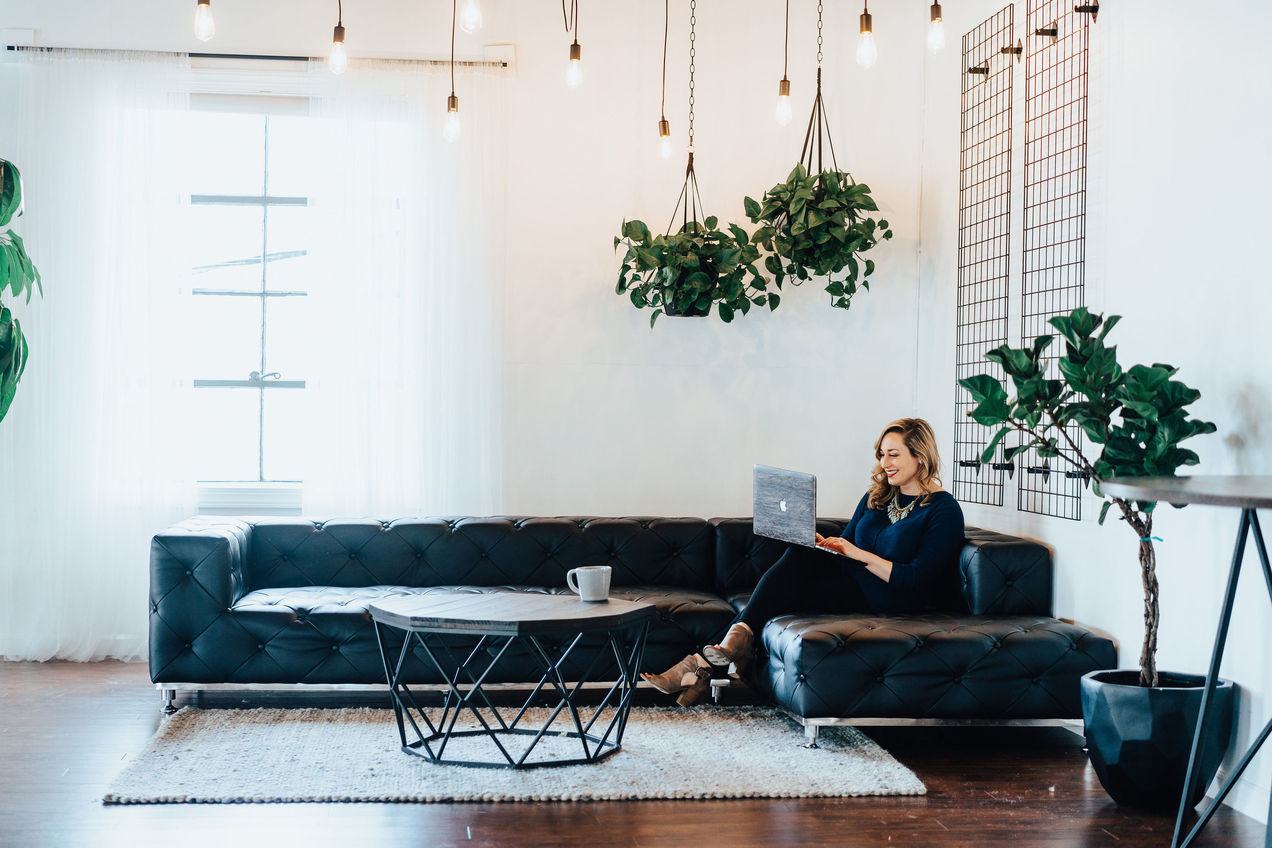 Woman Entrepreneur Works on Laptop on Couch