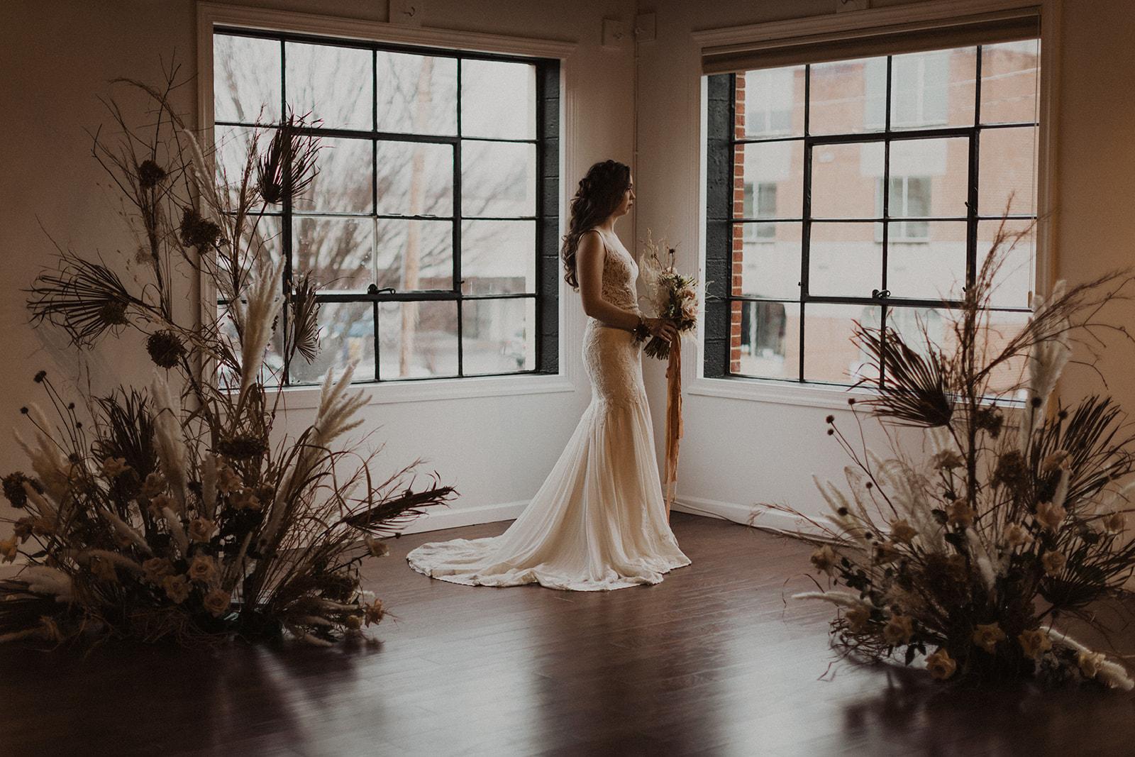 Organic Bride in Industrial Windows at Wedding Venue