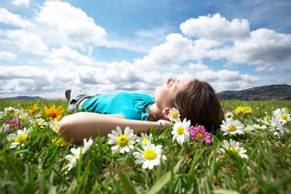 Girl-Resting-Meadow-585x390.jpg