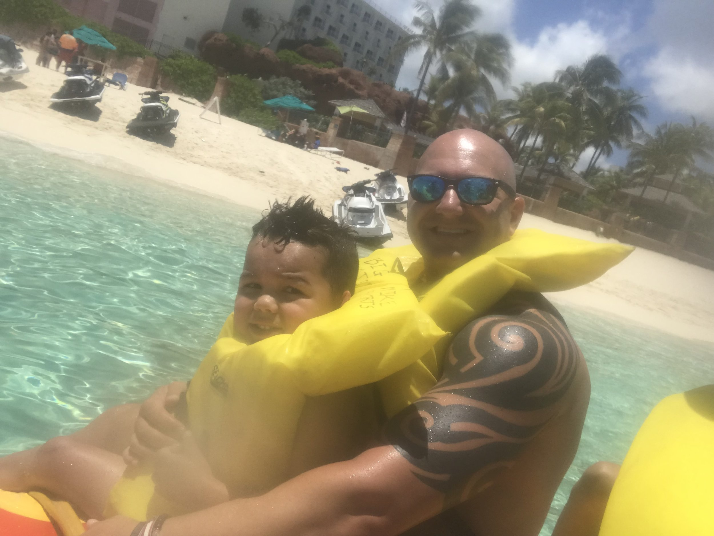 It's blurry because I had my waterproof case on. We took the boys on a banana boat ride. They didn't like it because the water smacked them in the face most of the time.