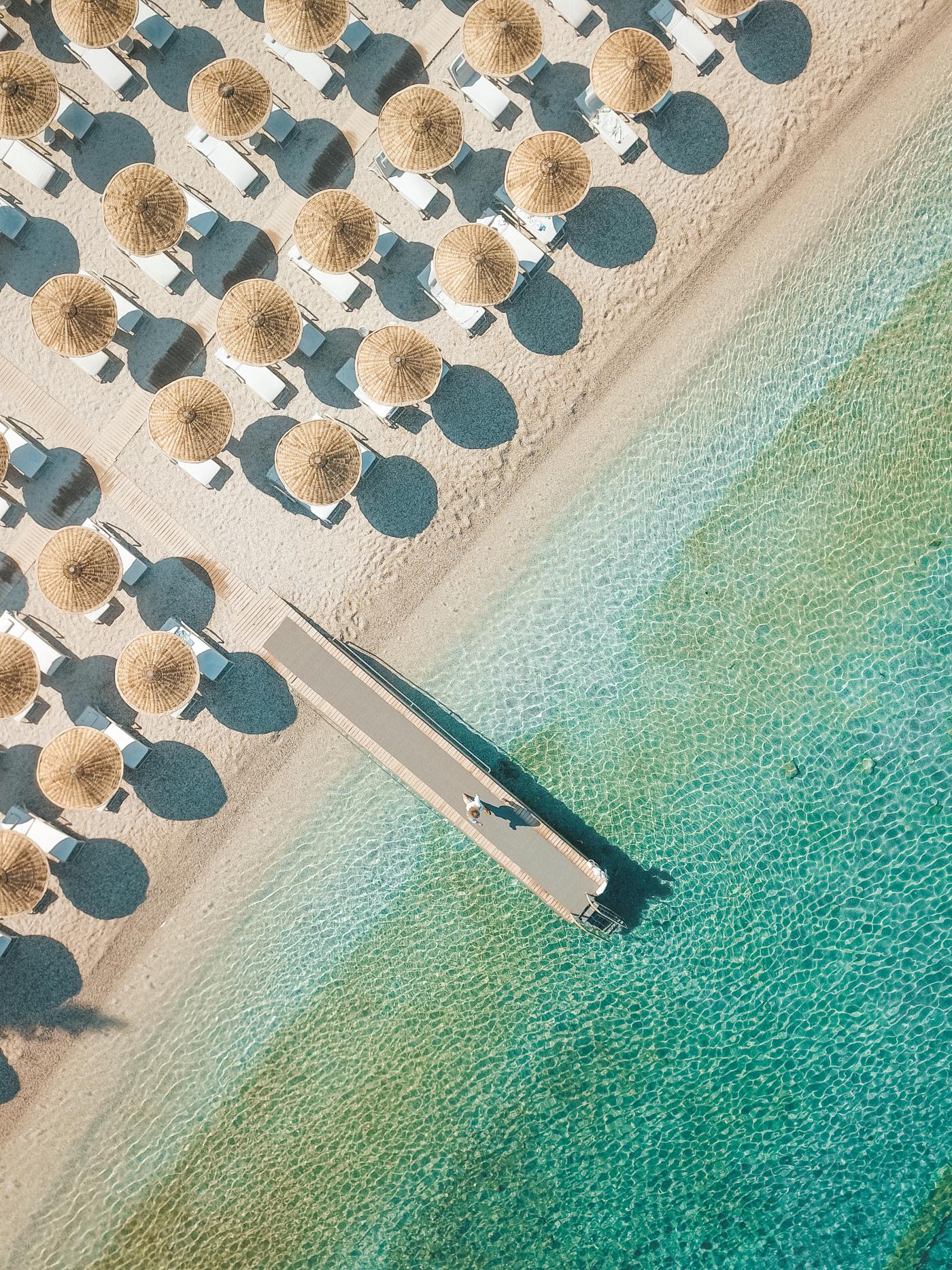 Aerial drone shot of the Hillside Beach Club beach and dock.