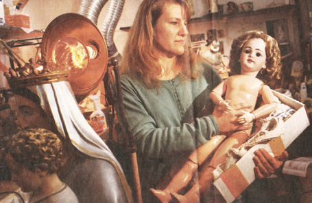 Nancy Lucken hold the doll she helped restore.