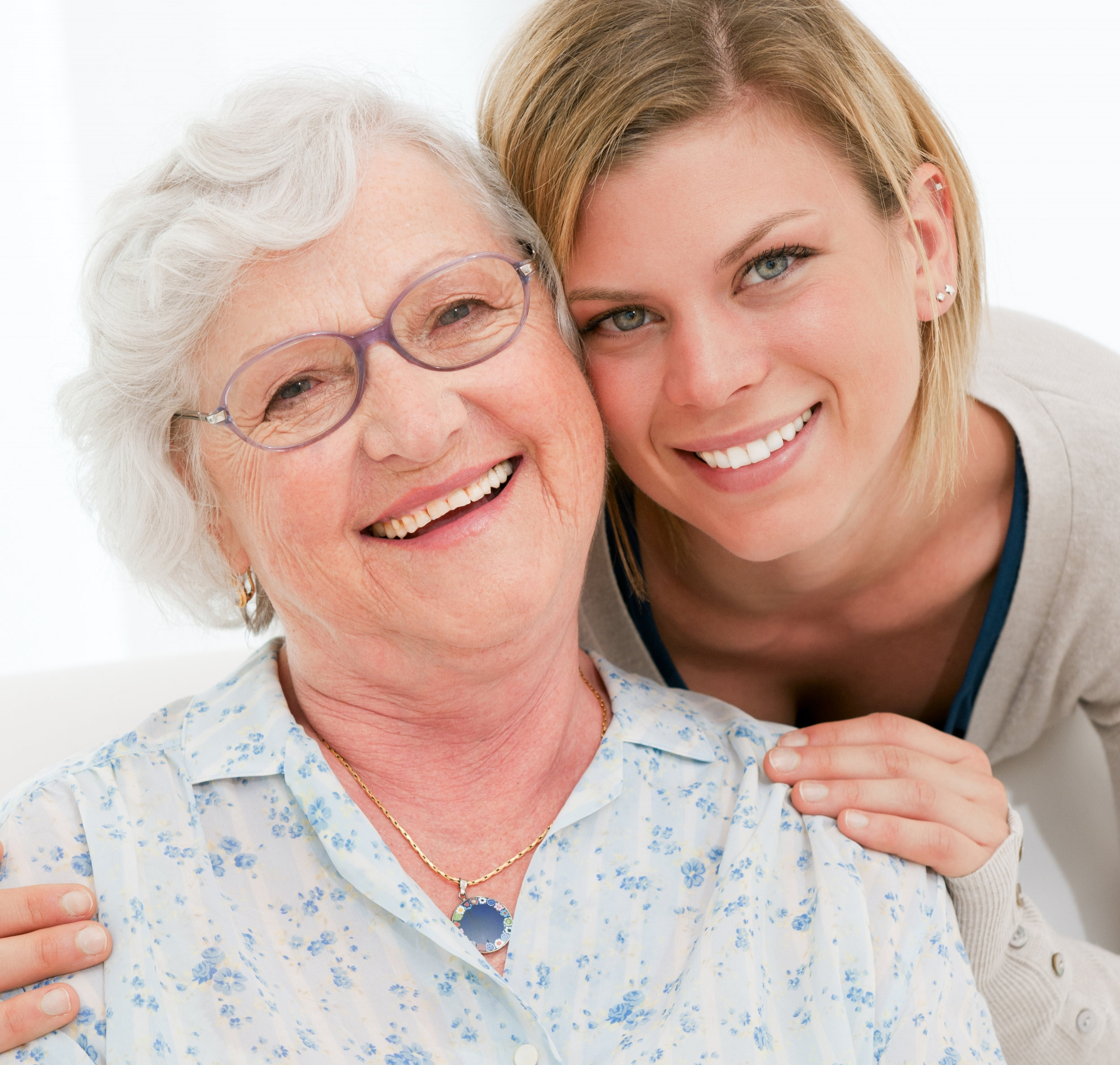 Two women smiling.