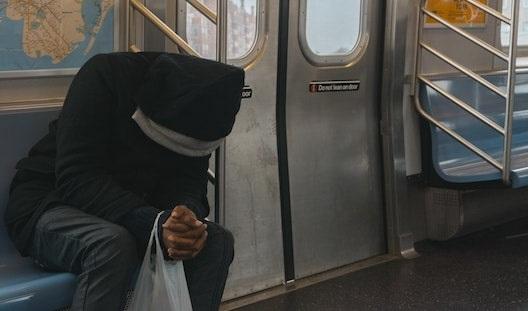 MIKONOWICZ-adult-subway-alone-min.jpg
