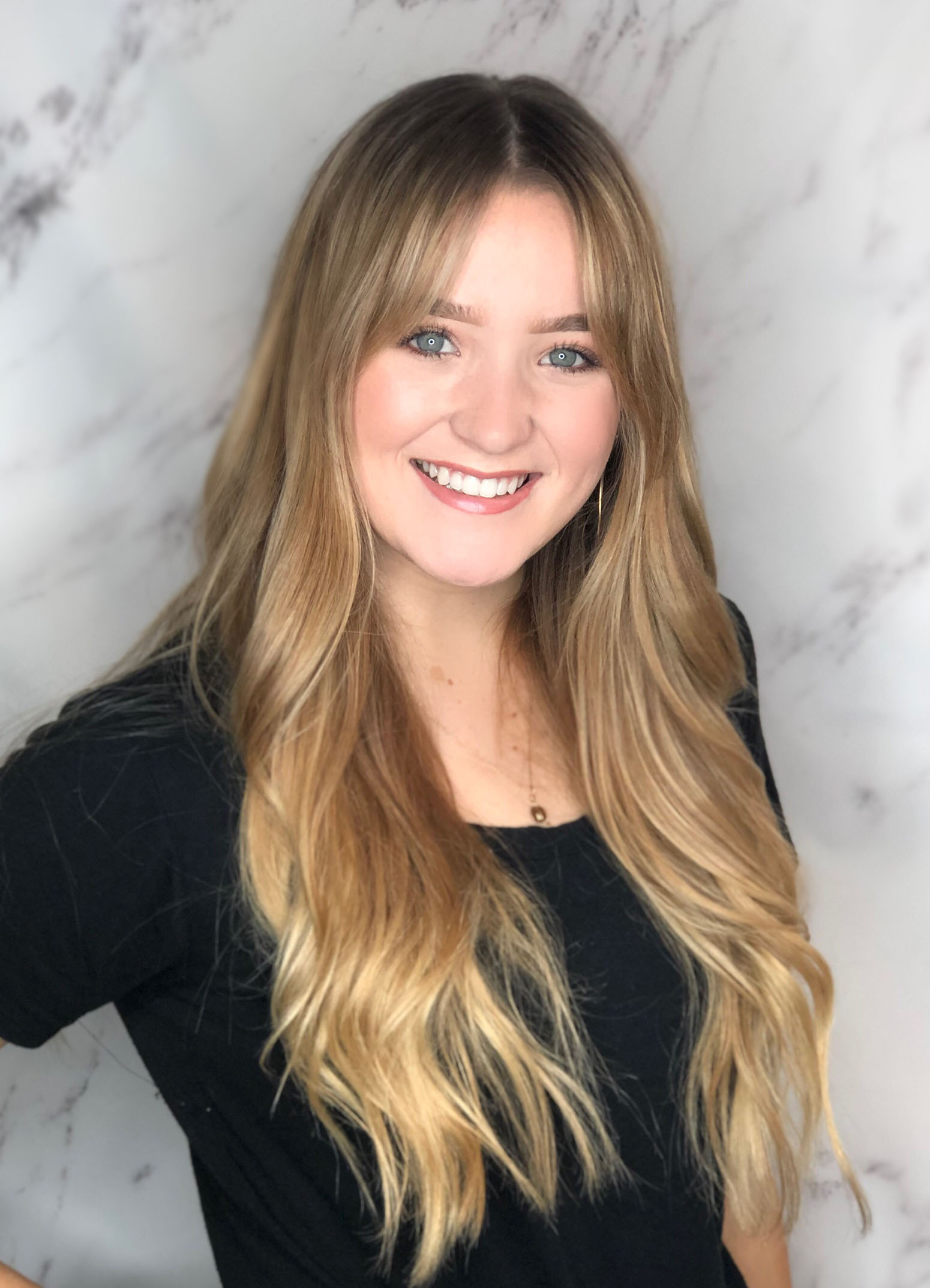 "Michelle's passion is to make your hair dreams become a reality. She goes above and beyond to make an experience you'll never forget. Whether you want to become a ""blonde bombshell"" or a ""chocolatey brown"", she will have you leaving with a smile!"
