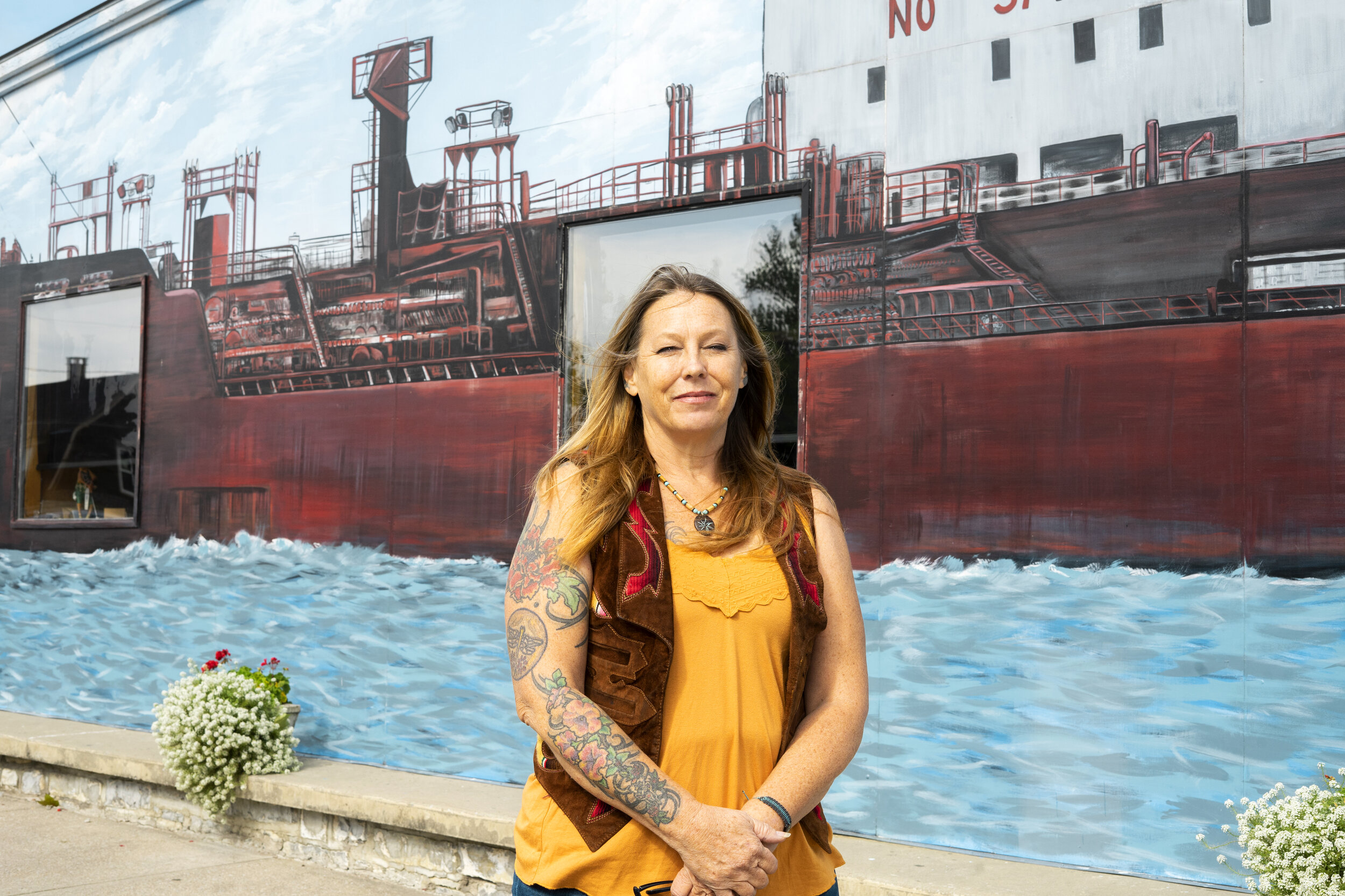 Kelly Curry is the professional muralist responsible for the expansive paintings that bring the buildings of Clayton to life. Curry, who started painting only eighteen years ago, now has about five hundred and fifty total murals across seven states and two countries, including a total of nine in Clayton itself.