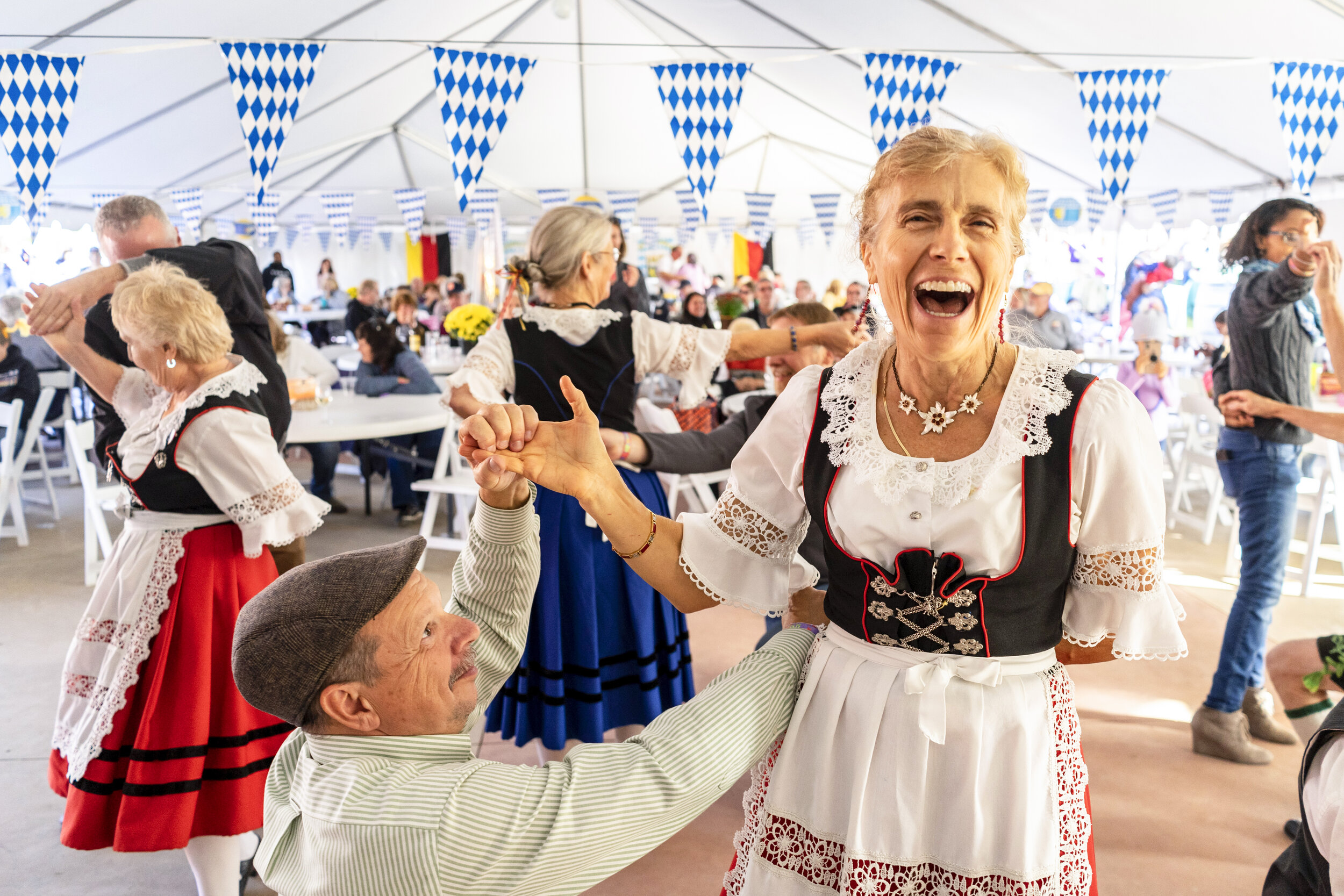 The Enzian Bavarian Band & Dancers teach crowd members traditional German styles of dance at the Oktoberfest celebration in Alexandria Bay.