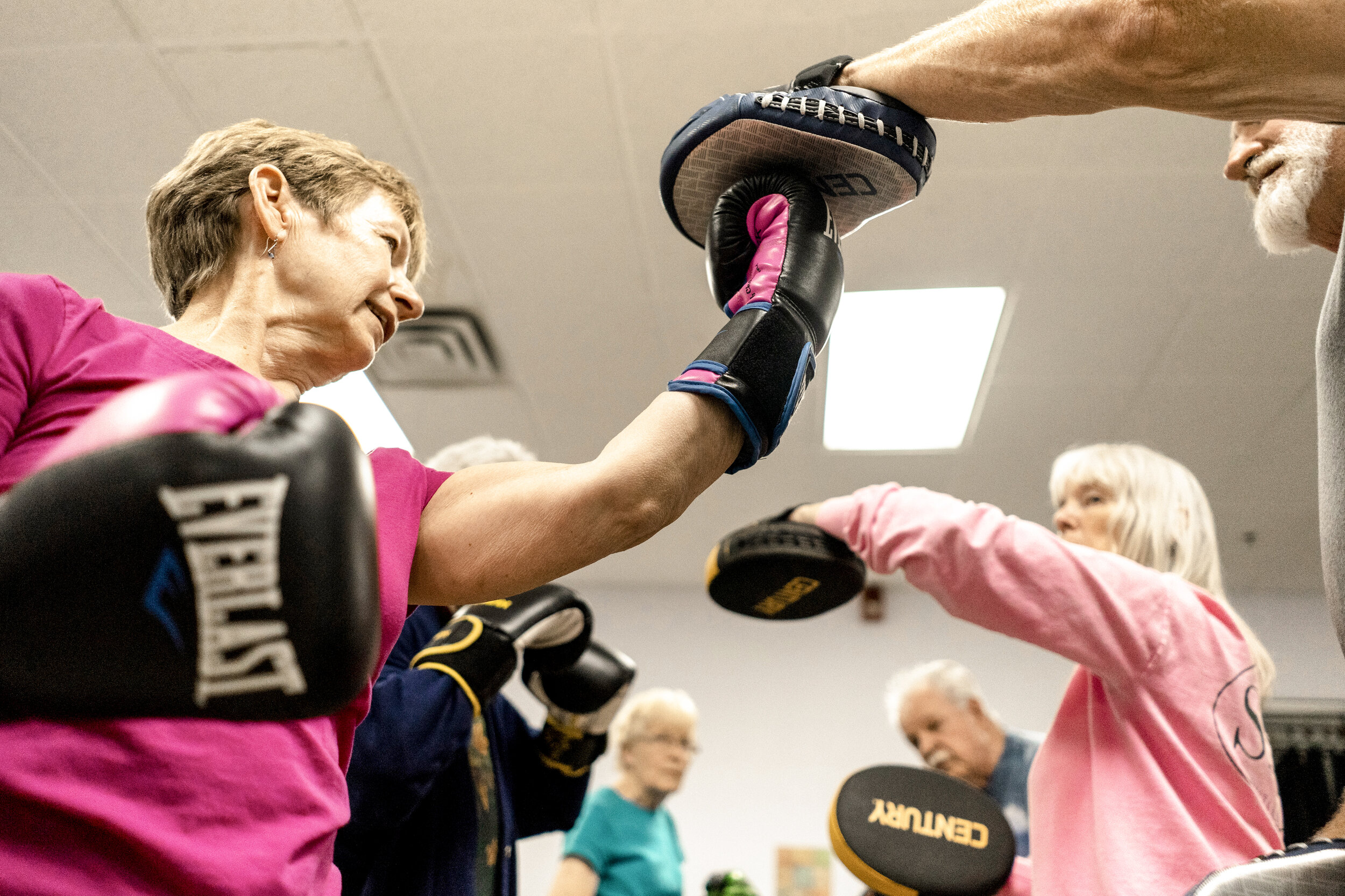 Francine King and her husband Bob King are the lead organizers and instructors of the Balanced Boxing course held twice weekly at the Fairgrounds YMCA. Both have a strong belief in the power of reclaiming motion and building community through boxing for people with Parkinson's.