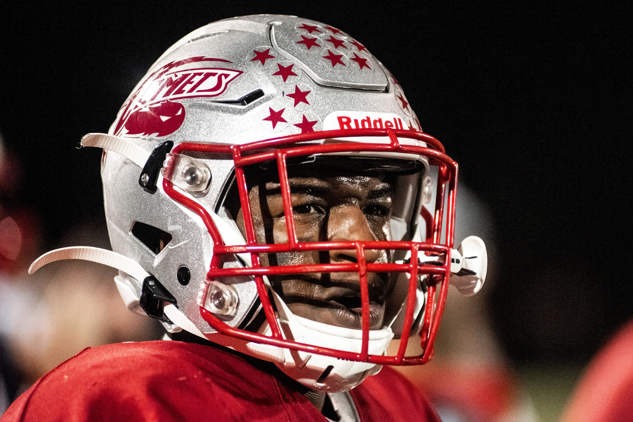 Carthage Football's Fombo Azah looks out into the field from the sidelines of the homecoming game against Indian River in Carthage, NY.
