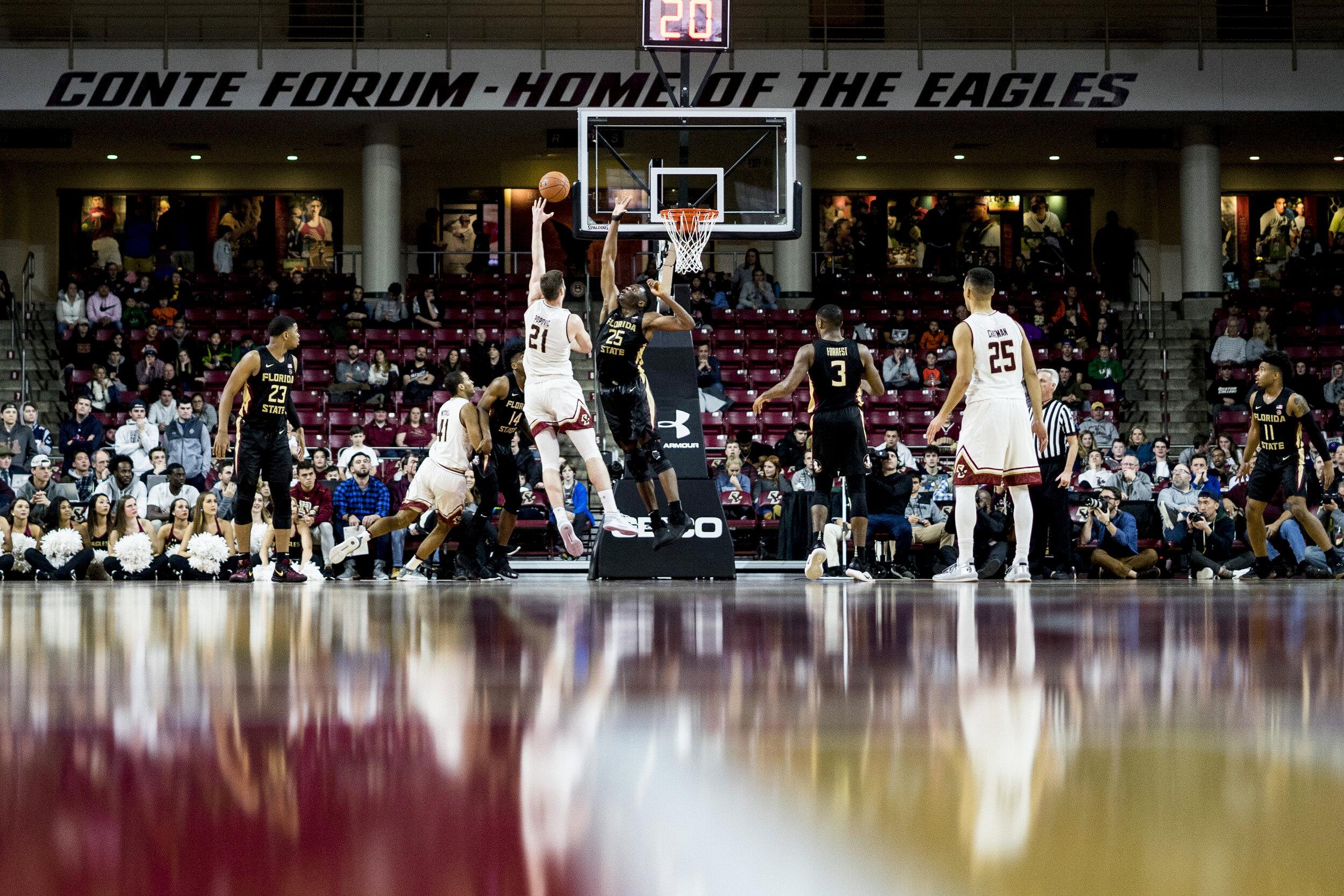 Forward Nik Popovik, of Boston College Men's Basketball, is blocked by Mfiondu Kabengele, of Florida State University     at Conte Forum in Newton, MA.