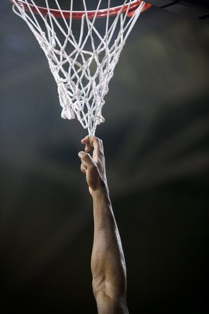 A Florida State player hangs on the net during pregame warmups in the game against Boston College at Conte Forum in Newton, MA.