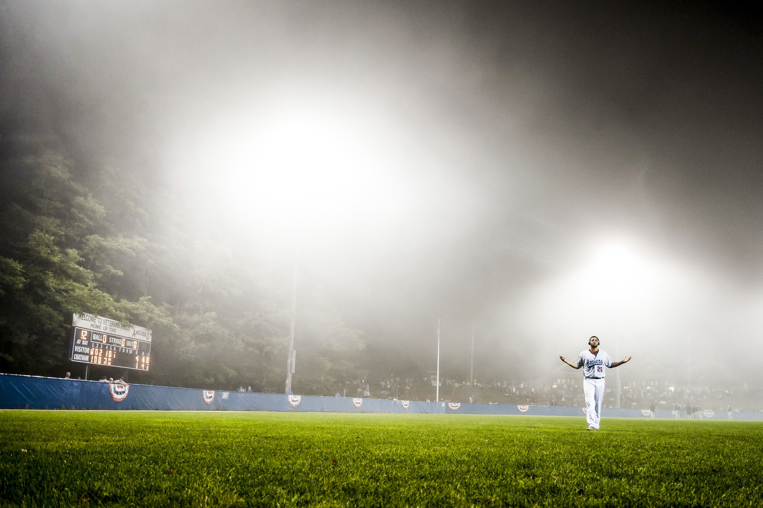 Chatham Anglers pitcher Alex Manoah stretches to stay warm in a fog delay during the Cape Cod Baseball League Final against the Wareham Gatemen at Veterans Field in Chatham, MA.