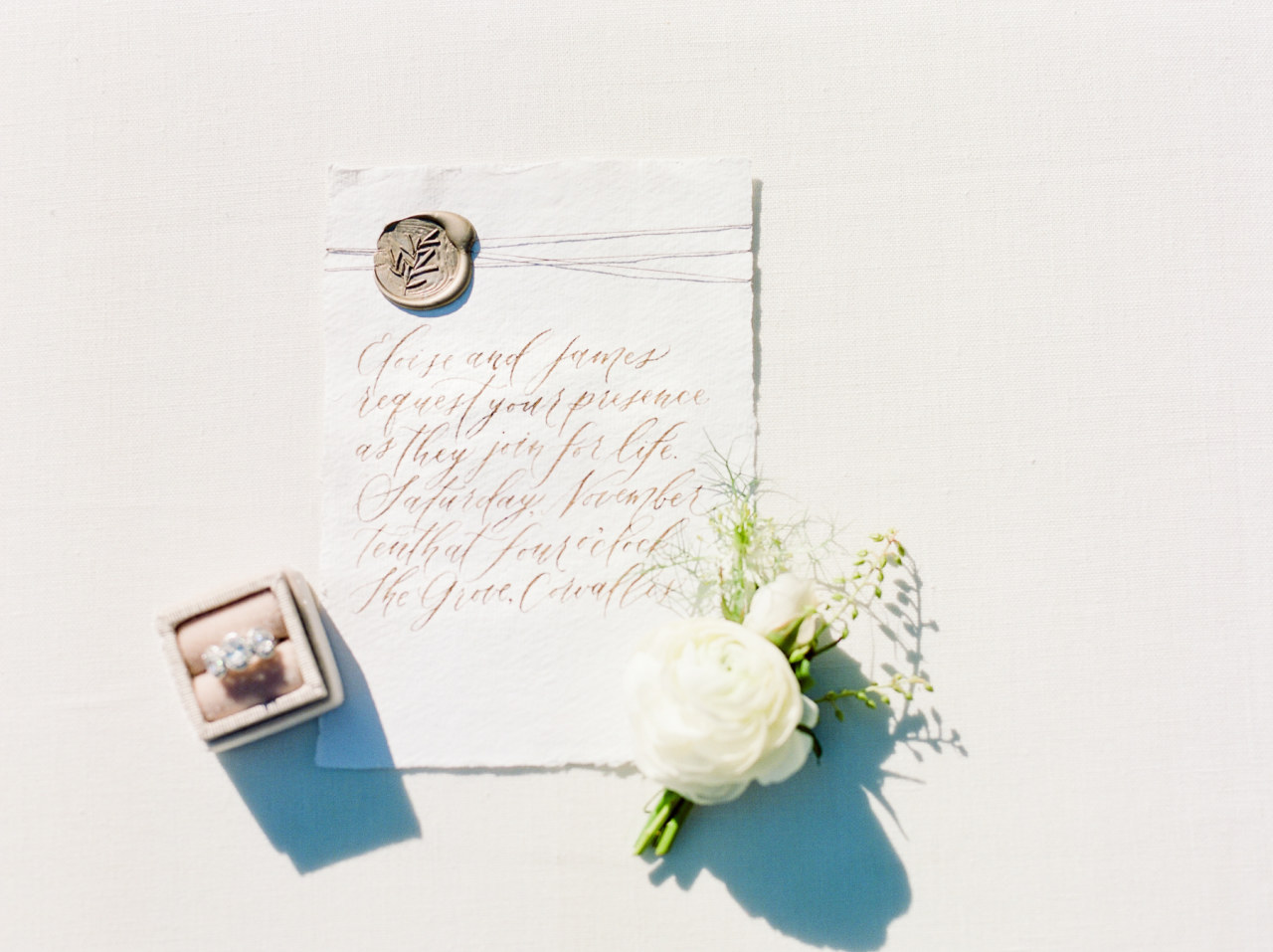 Timeless heirloom wedding inspiration. Handmade paper calligraphy invitations with wax seal by Caitlin O'Bryant Design. Photography by Mylyn Wood Photography. Paper Goods by Caitlin O'Bryant Design. Florals: Caroline Reusen Flowers. Models: Jens Behind the Lens. HAMU: Coreene Collins Hair. Styling Assistant: Jessica Staley.