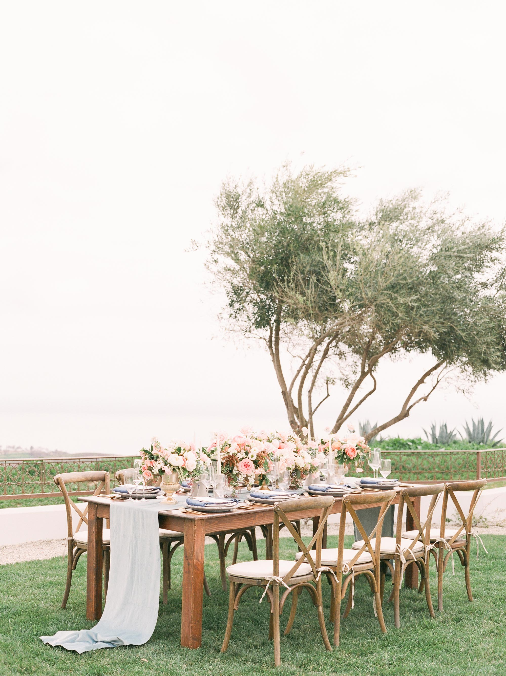 Romantic and light spring wedding on the cliffs of Malibu. Photo by Julie Paisley. Florals by Royal Bee Flower Co. Stationery by Caitlin O'Bryant Design. Venue: Deer Creek Ridge.