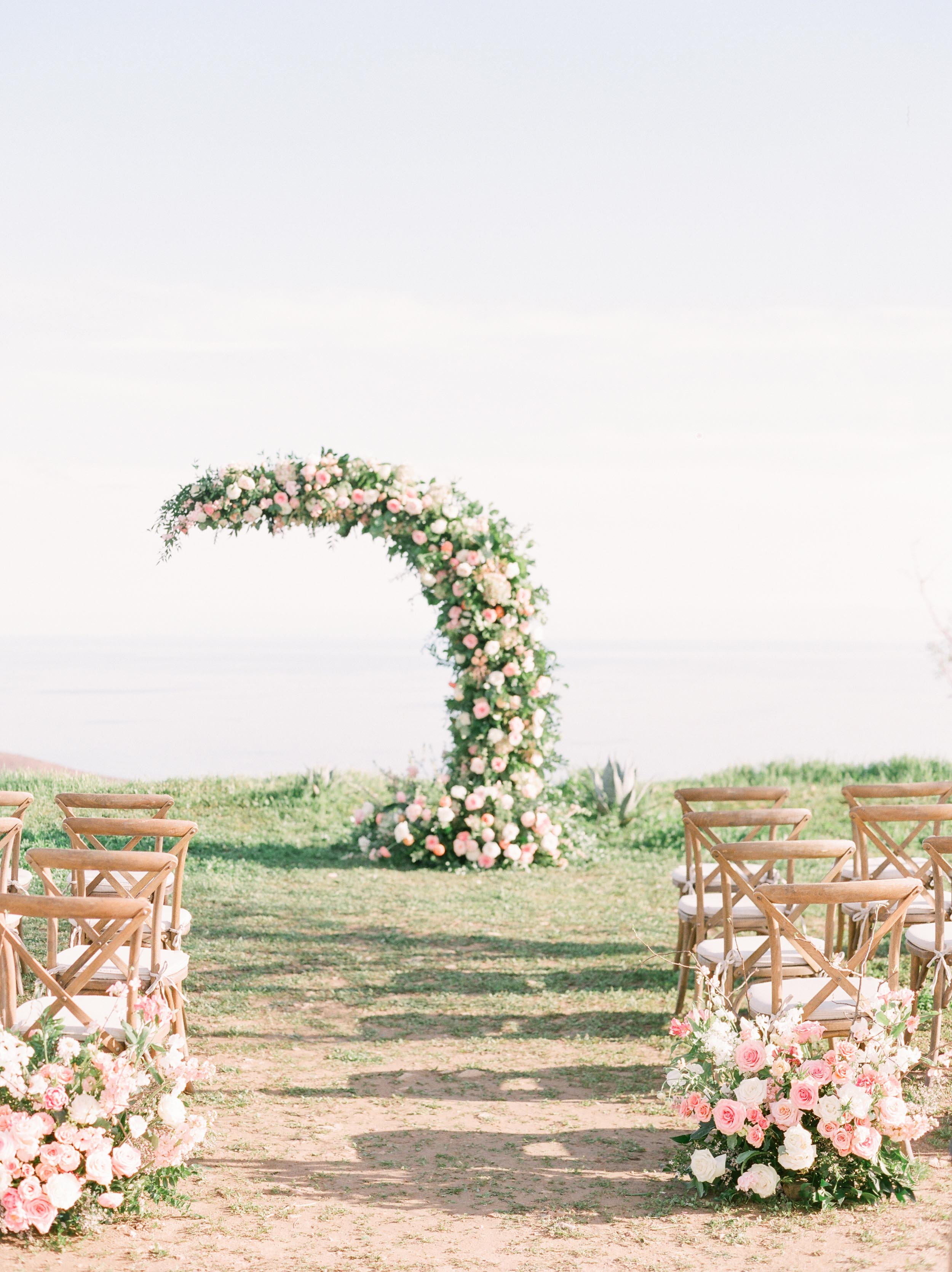 Romantic and light spring wedding on the cliffs of Malibu. Photo by Julie Paisley. Florals by Royal Bee Flower Co. Stationery by Caitlin O'Bryant Design. Venue: Deer Creek Ridge. Planning: Heather Benge Events.