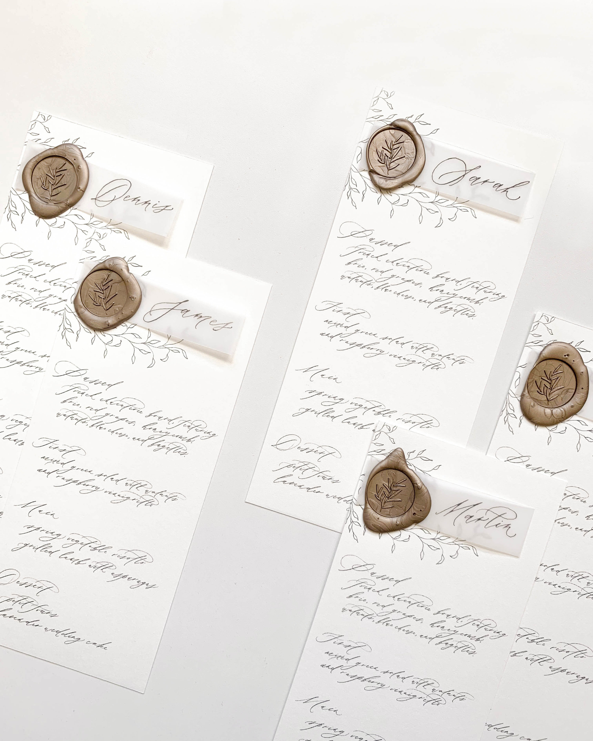 Fine art handmade paper wedding invitations with a botanical crest and venue illustration. Full calligraphy, vintage postage. Vintage, romantic, and elegant wedding stationery.