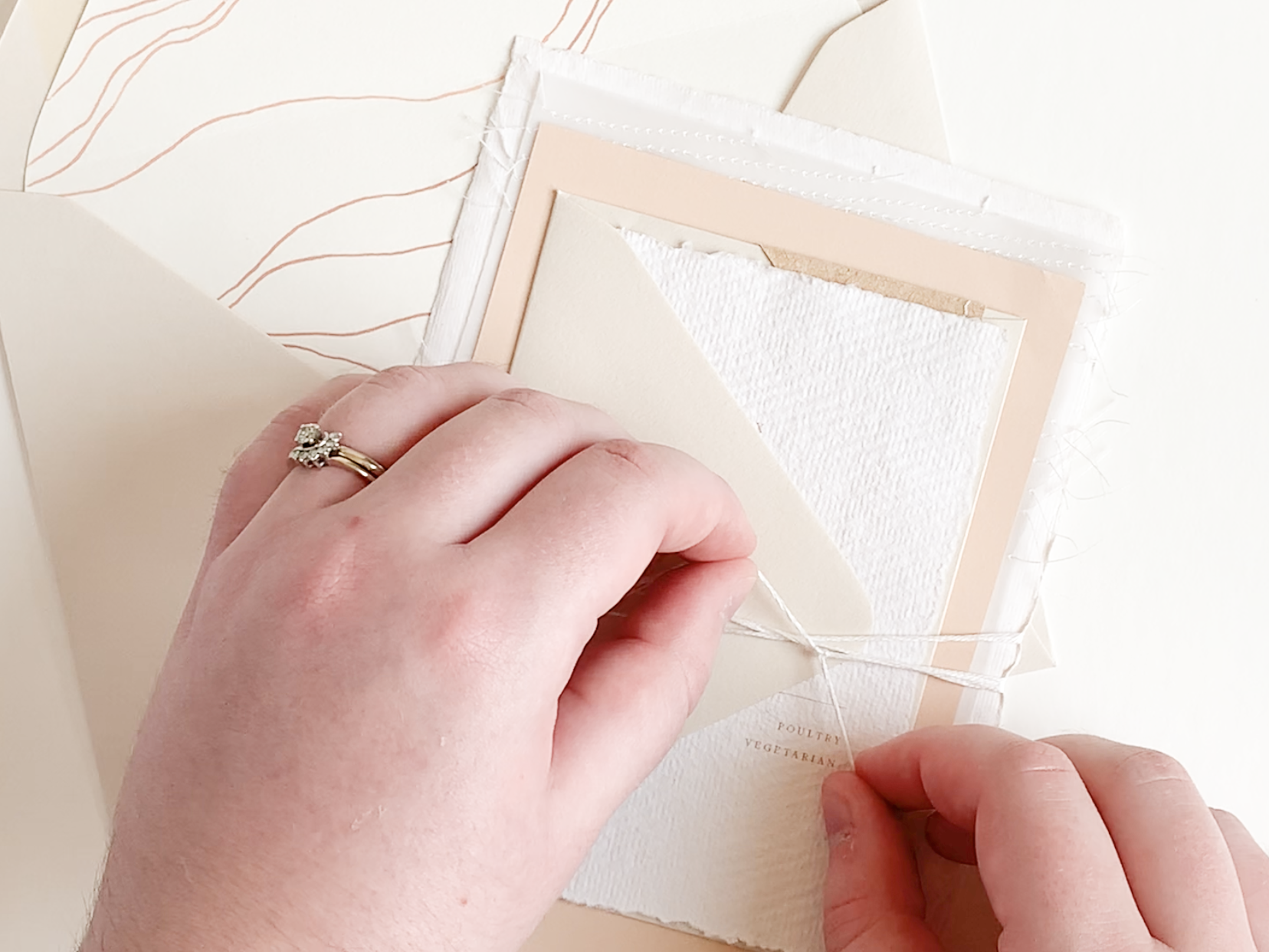Behind the Scenes: Assembling Wedding Invitations. A behind the scenes look at how we assemble our custom and semi-custom luxury wedding invitations.