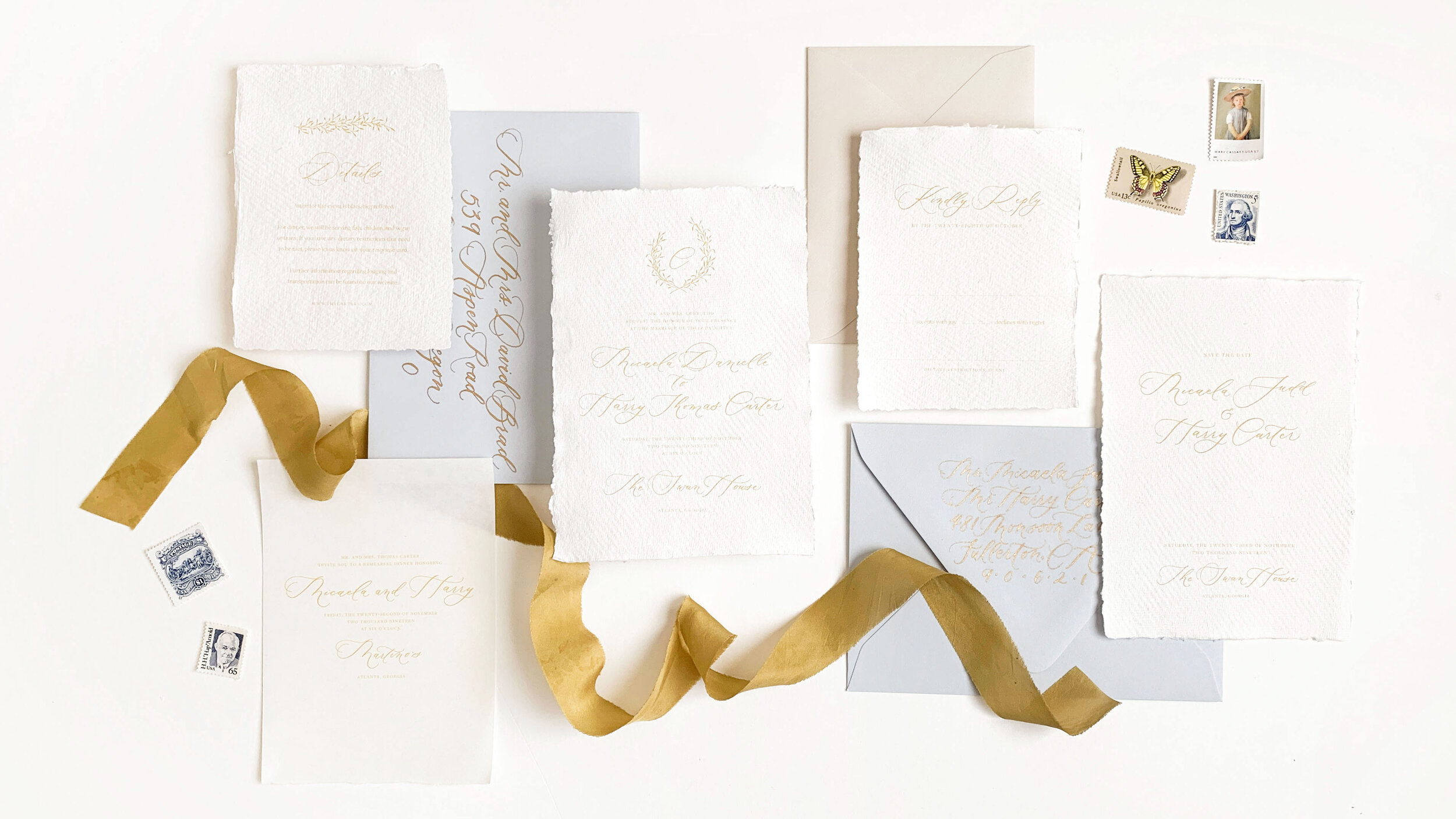 Elegant and timeless wedding invitations with crest and romantic modern calligraphy. Printed on handmade paper and tied with hand-dyed silk ribbon. Calligraphy addressing and vintage postage. Luxury wedding invitations.