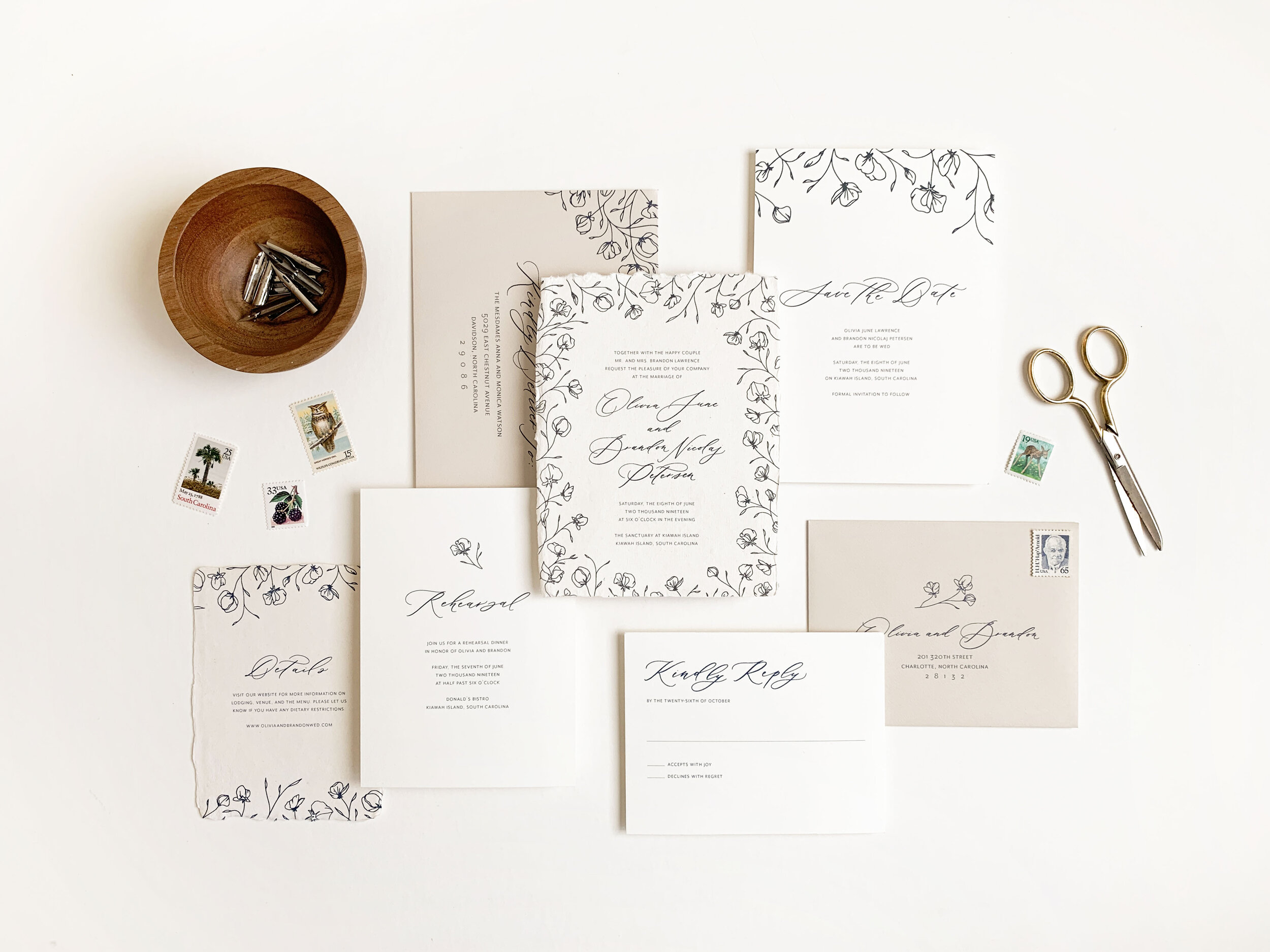 Elegant and timeless wedding invitations with floral illustrations romantic modern calligraphy. Printed on handmade paper, assembled with vellum wrap, thread, and a wax seal. Printed calligraphy addressing and vintage postage. Luxury wedding invitations.