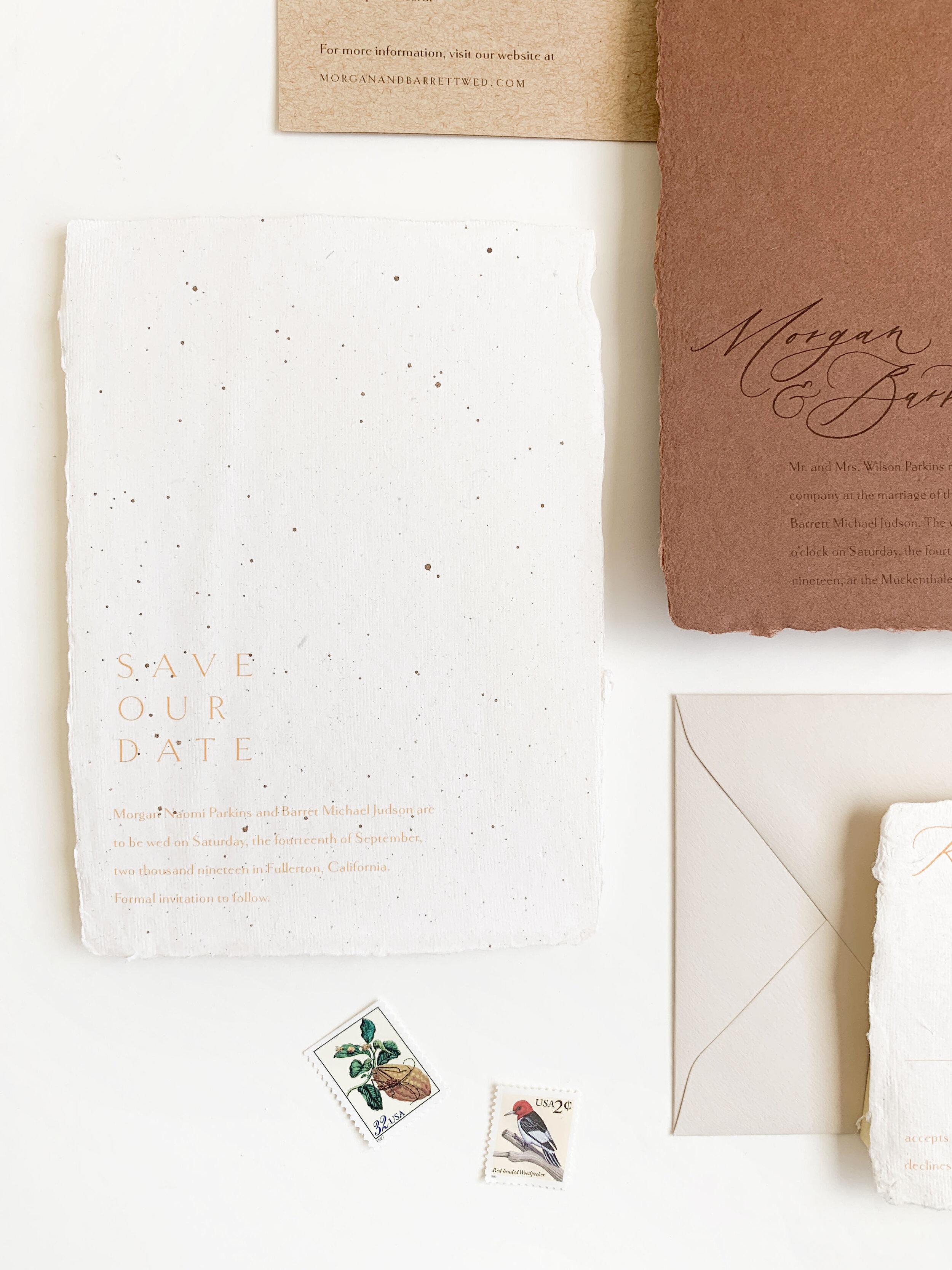 Modern wedding invitations on handmade paper. Terra cotta wedding invitations. Speckled paper wedding invitations. Calligraphy minimalist wedding invitations with vintage postage and calligraphy addressing.
