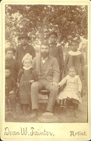 """- Cheyenne Children at boarding school: circa 1890 """"My great-grandmother (Mary) is the little girl in the white dress on the bottom right of the photo. The man in the center is the Mennonite preacher that was assigned to our settlement/land allotments (we don't have a reservation). The white girl with the hat on the other side of him is his daughter. The little boy to the left of the preachers daughter is my Granda Mary's brother, David. The rest are Cheyenne and Arapaho children and (my great grandmother's cousins) from the settlement that were all put on the train to go to Halstead Indian Boarding School in Kansas which was run by the Mennonites. The boy in the very back with the hat is John Pedro. I don't know the names of the other children. I met John's great grandson a few years ago. His grandson, Glen, moved to a small town next to mine. Wild huh?"""""""