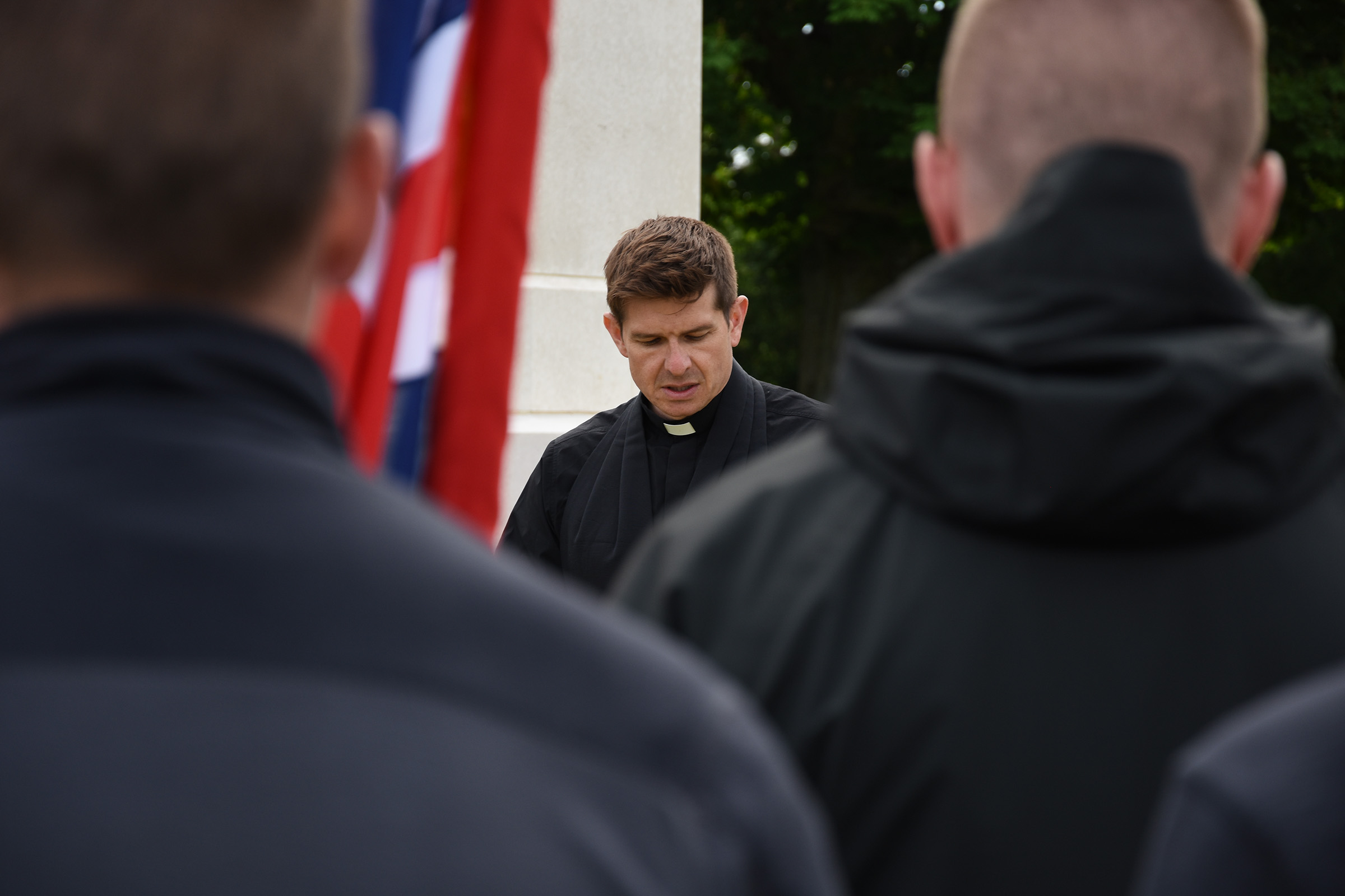 Rev. Ben Norton , Chaplain of 4th Battalion, The Yorkshire Regiment, at the Act of Remembrance at Bayeux War Cemetery
