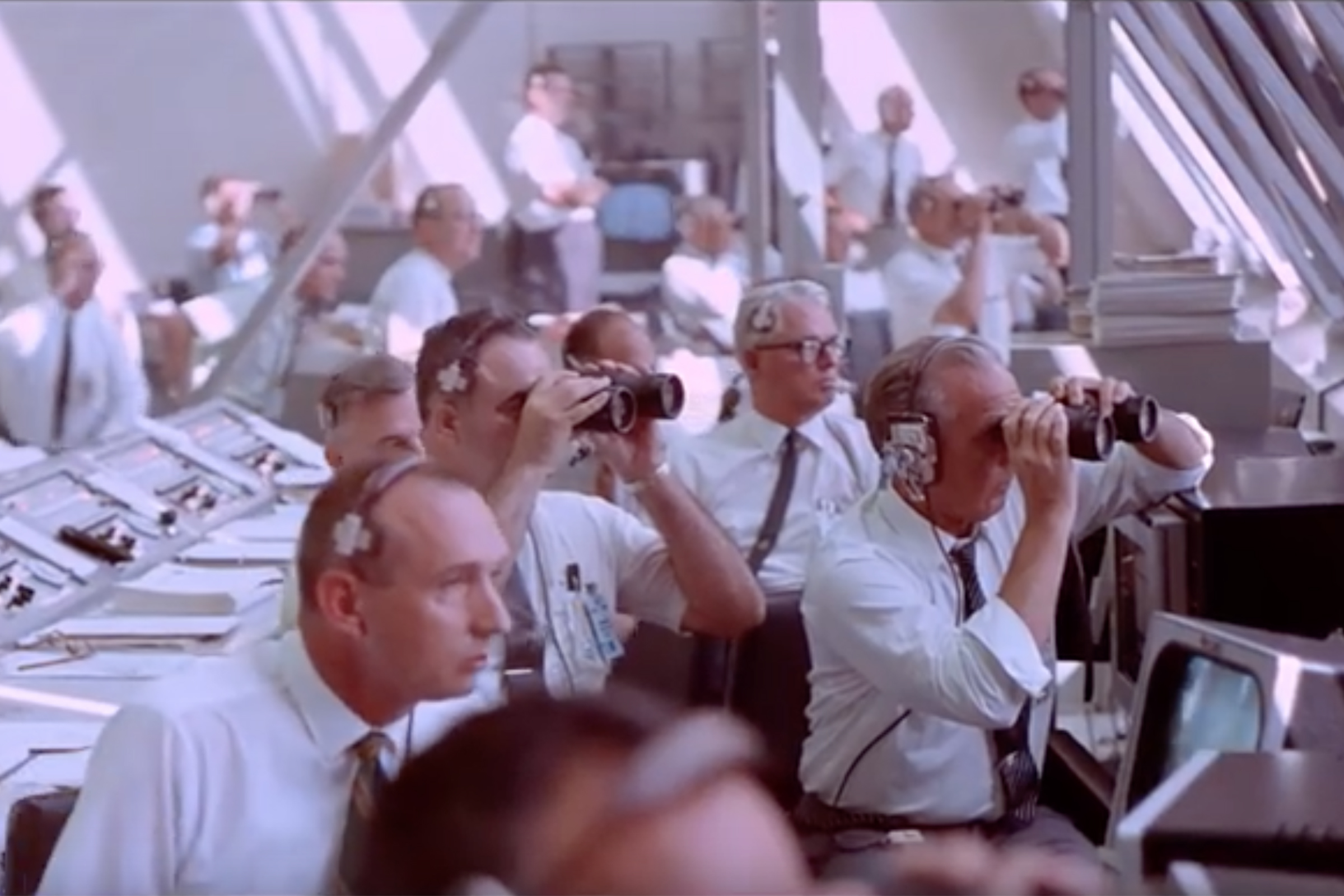 At Kennedy Space Center (Florida), the team at the Launch Control Center watch Apollo 11 as it lifts off in to Earth orbit.