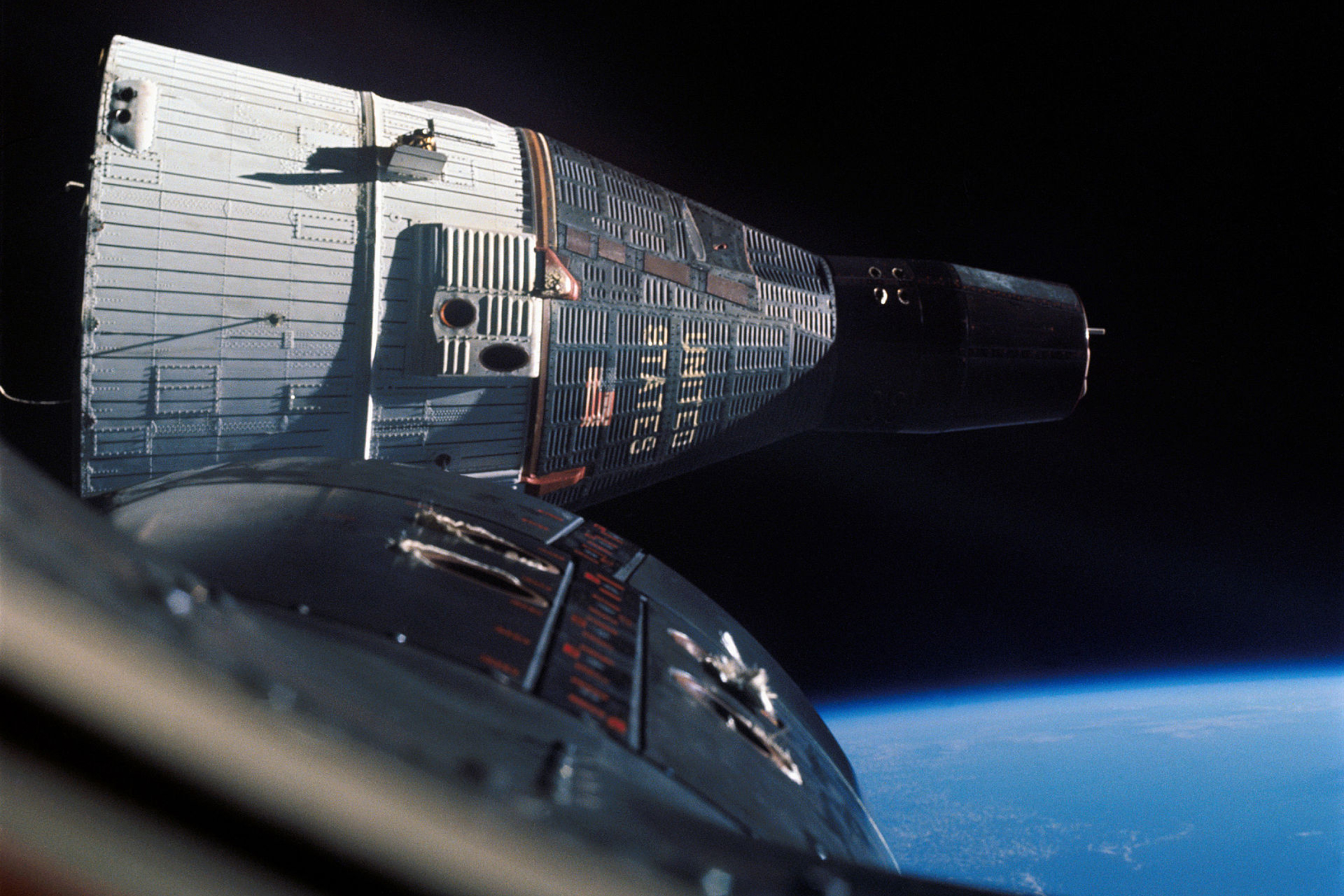 Project Gemini launched pairs of astronauts in each capsule, to practice mission critical operations prior to the Apollo program. Here Gemini 6 and 7 rendezvous in Earth orbit, in December 1965.