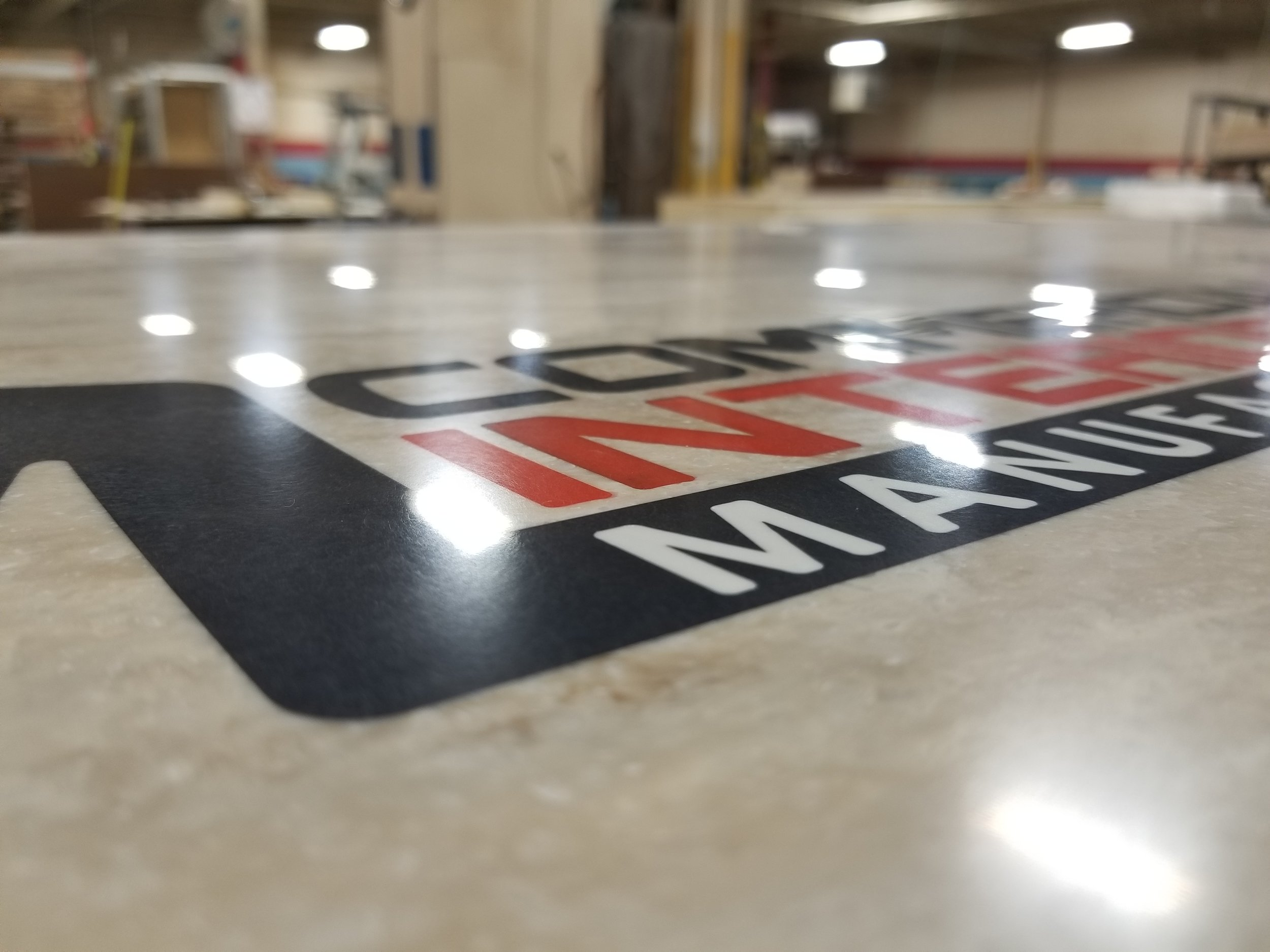 tabletop inlaid with a multi-colored logo