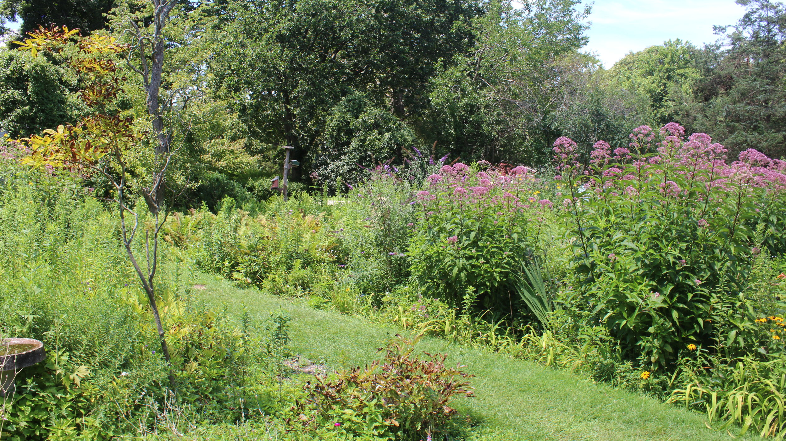 Gardens - A beautiful stained glass window shaped garden fills with color during the Spring, Summer and Fall.