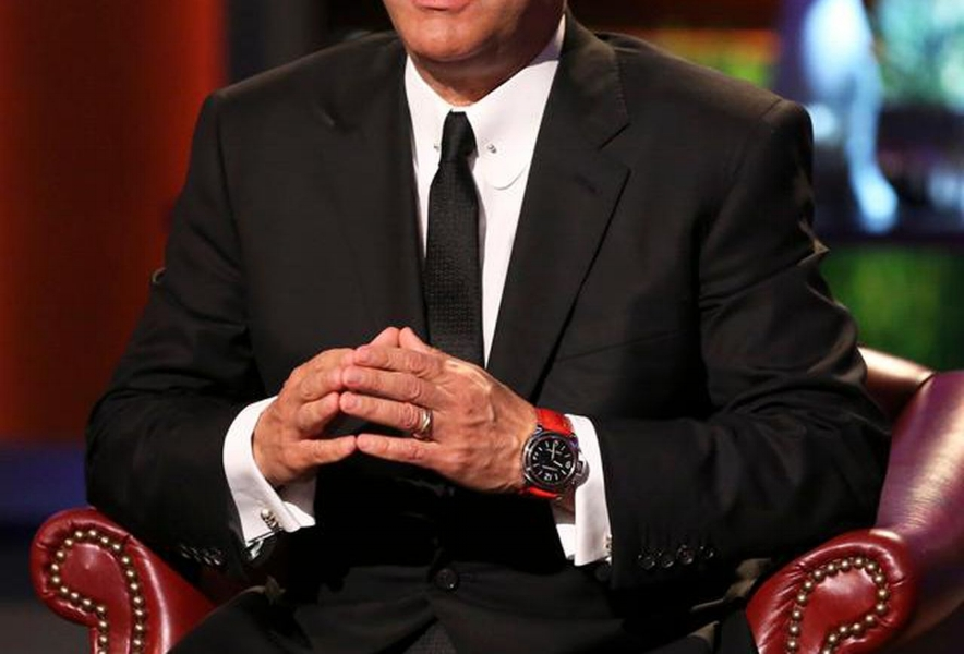 Kevin O'Leary showing off his Panerai Luminor Base.